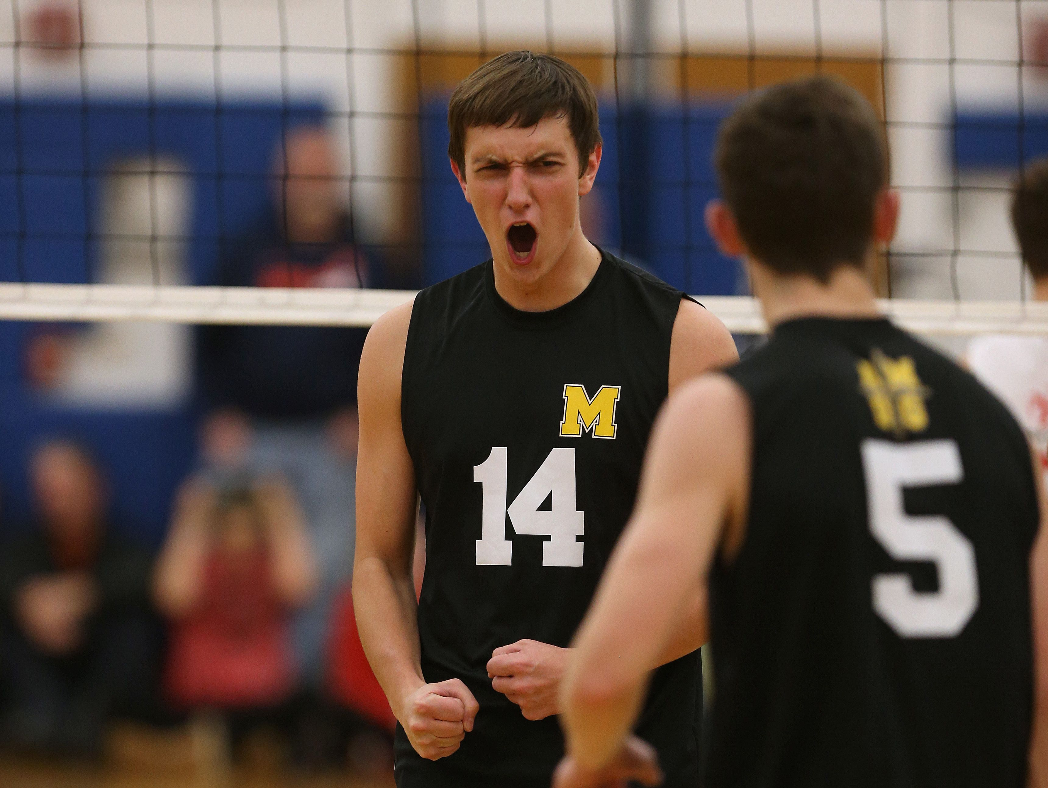 McQuaid's Christian Palleschi (14) celebrates with Spencer Wicken against Penfield in Class A final.