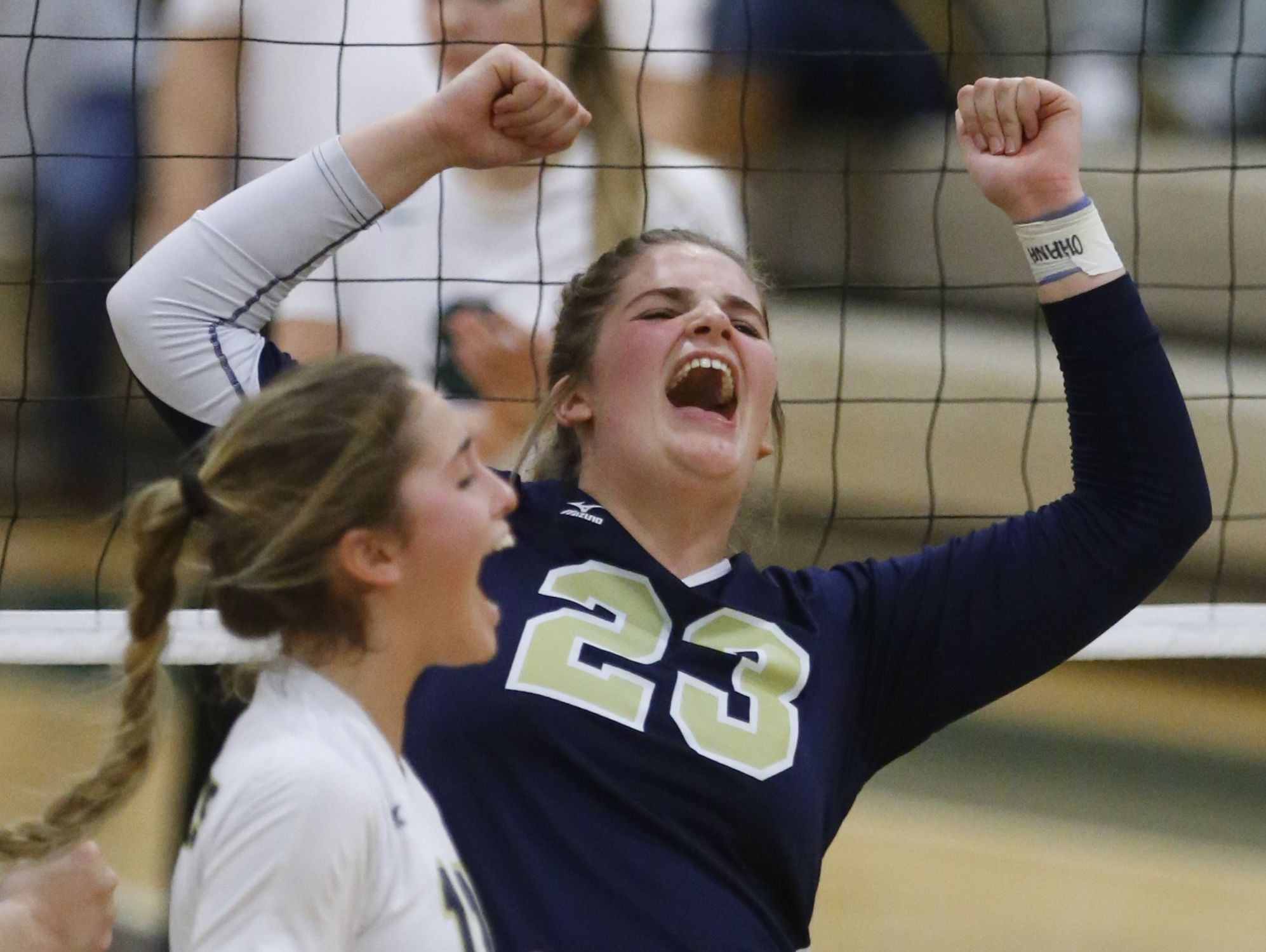 Delaware Military's Lindsay Wolfe (23) and Kirsten Longueira celebrate as they force a fifth set in their 3-2 win against Tower in a DIAA tournament semifinal at St. Mark's Thursday.