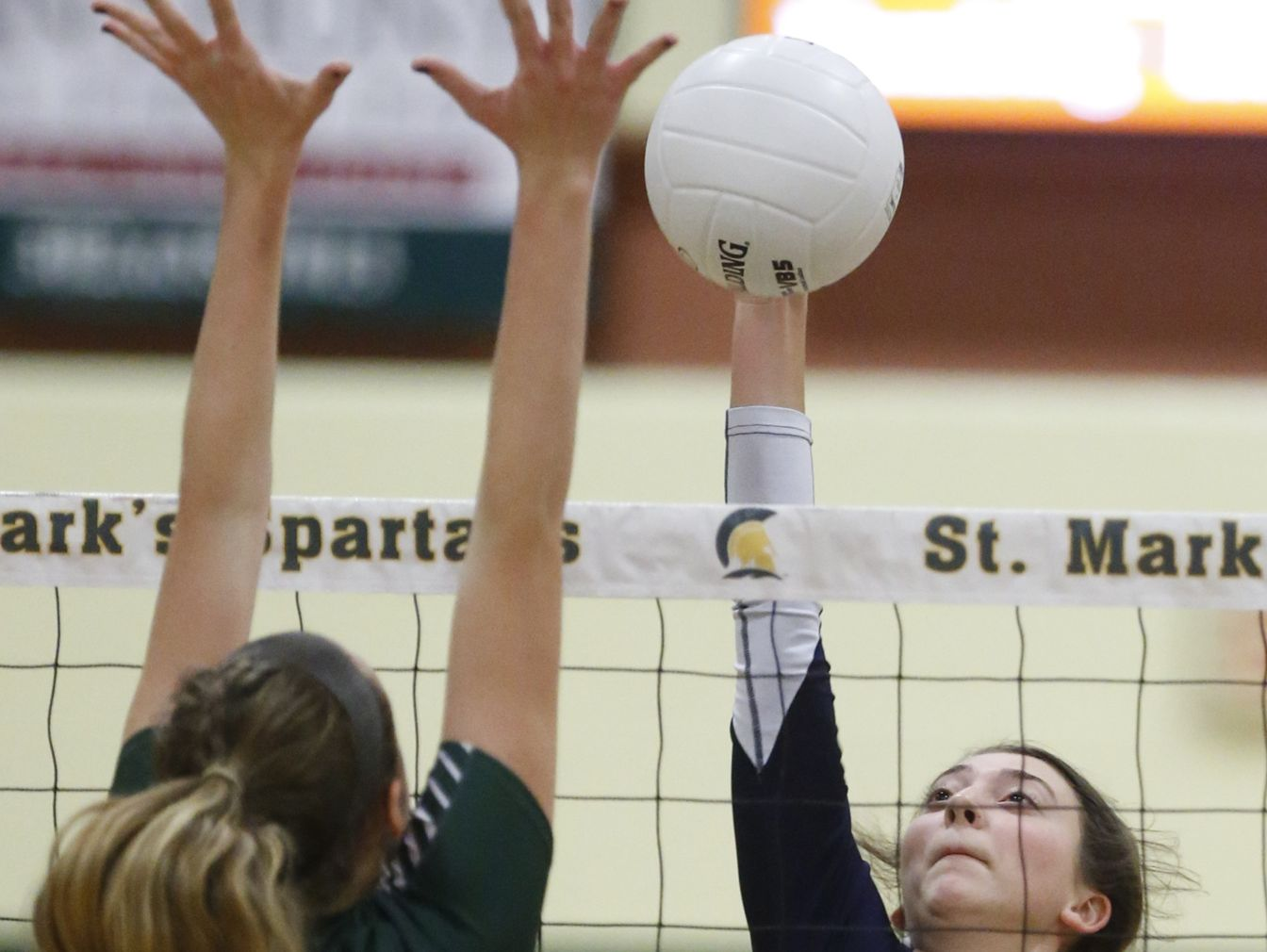 Delaware Military's Nina Tindall (18) battles at the net against Tower Hill's Kyra Caffrey in the first game of a DIAA tournament semifinal at St. Mark's Thursday.