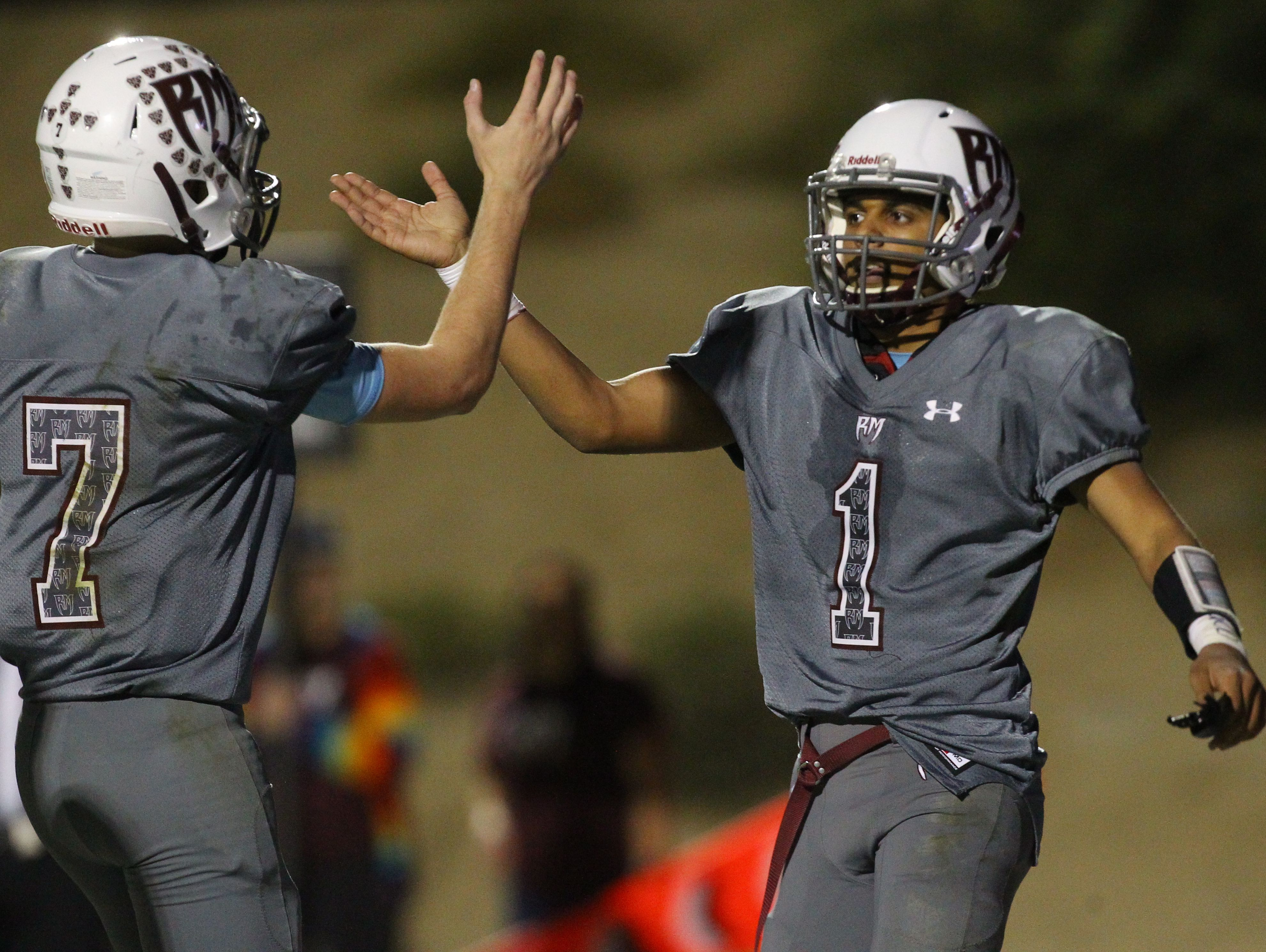 David Talley and Marques Prior of Rancho Mirage High School celebrate Prior's touchdown in the third quarter of their CIF post-season game against Los Amigos High School at home.