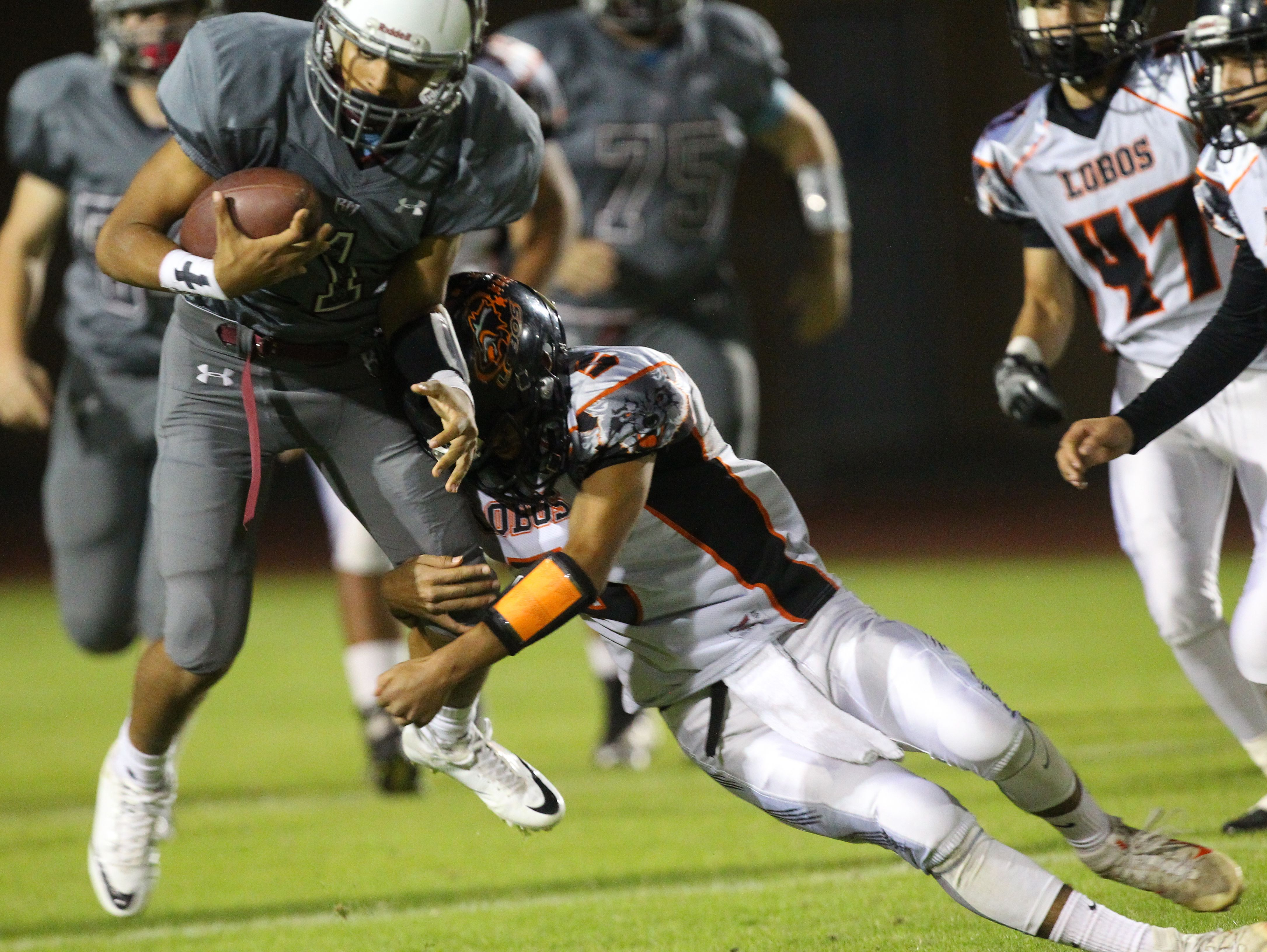 Marques Prior of Rancho Mirage High School runs for yardage in the third quarter of their CIF post-season game against Los Amigos High School at home.