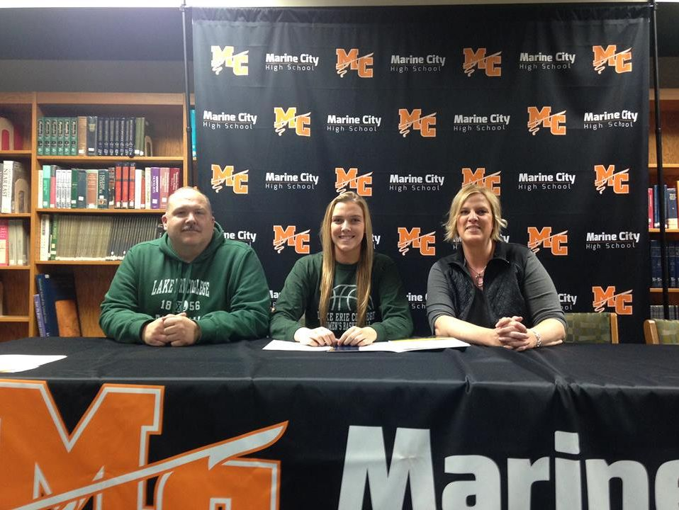 Paige Tranchida, middle, poses with her parents, Mike and Tracy, after signing her Letter of Intent to Lake Erie College.