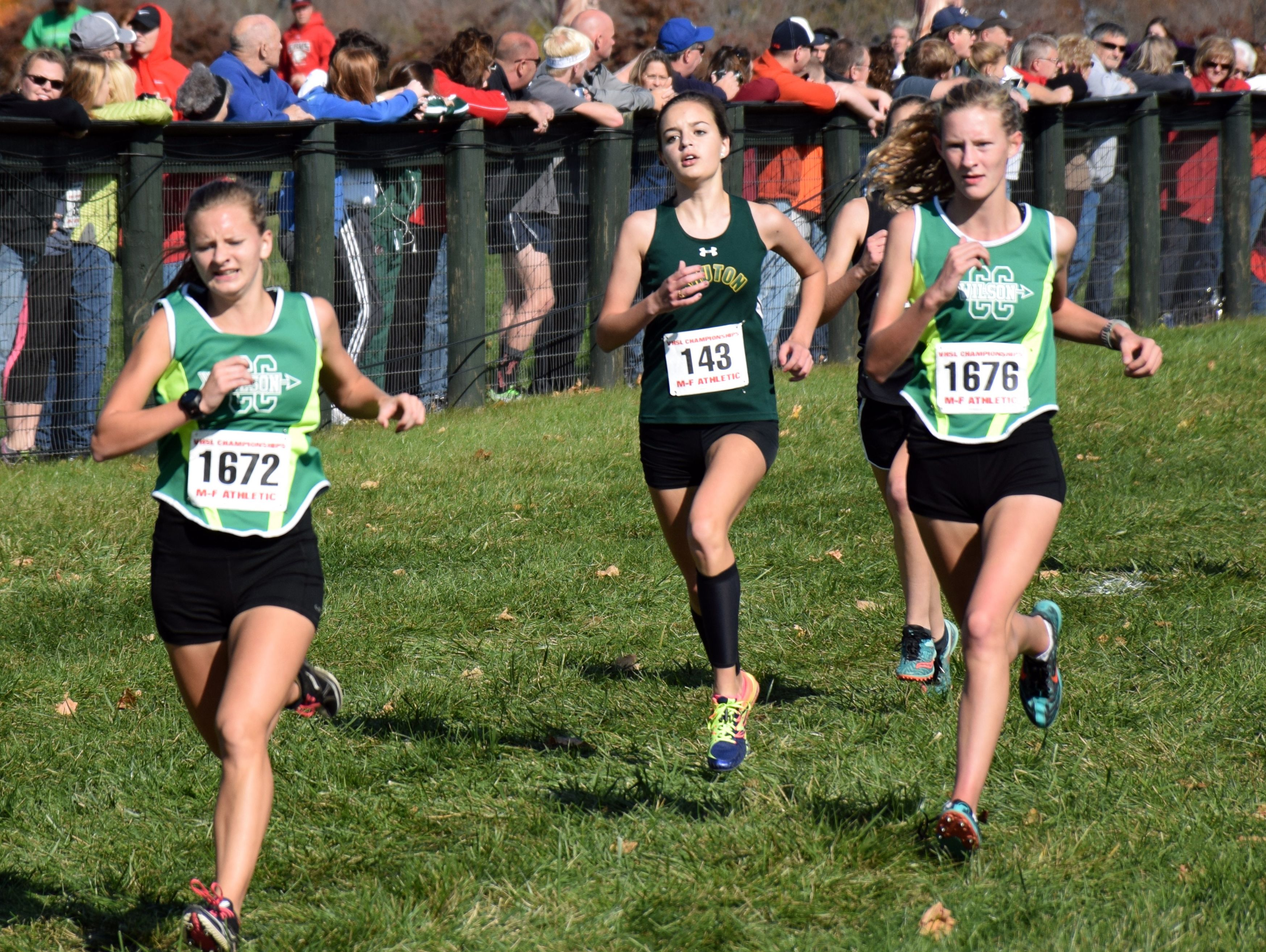 Wilson Memorial's Natalie Prye, left, and Spencer Tuttle, right, head down the final stretch of the Group 2A girls race at the VHSL cross country championships at Great Meadow in The Plains on Friday, Nov. 11, 2016.