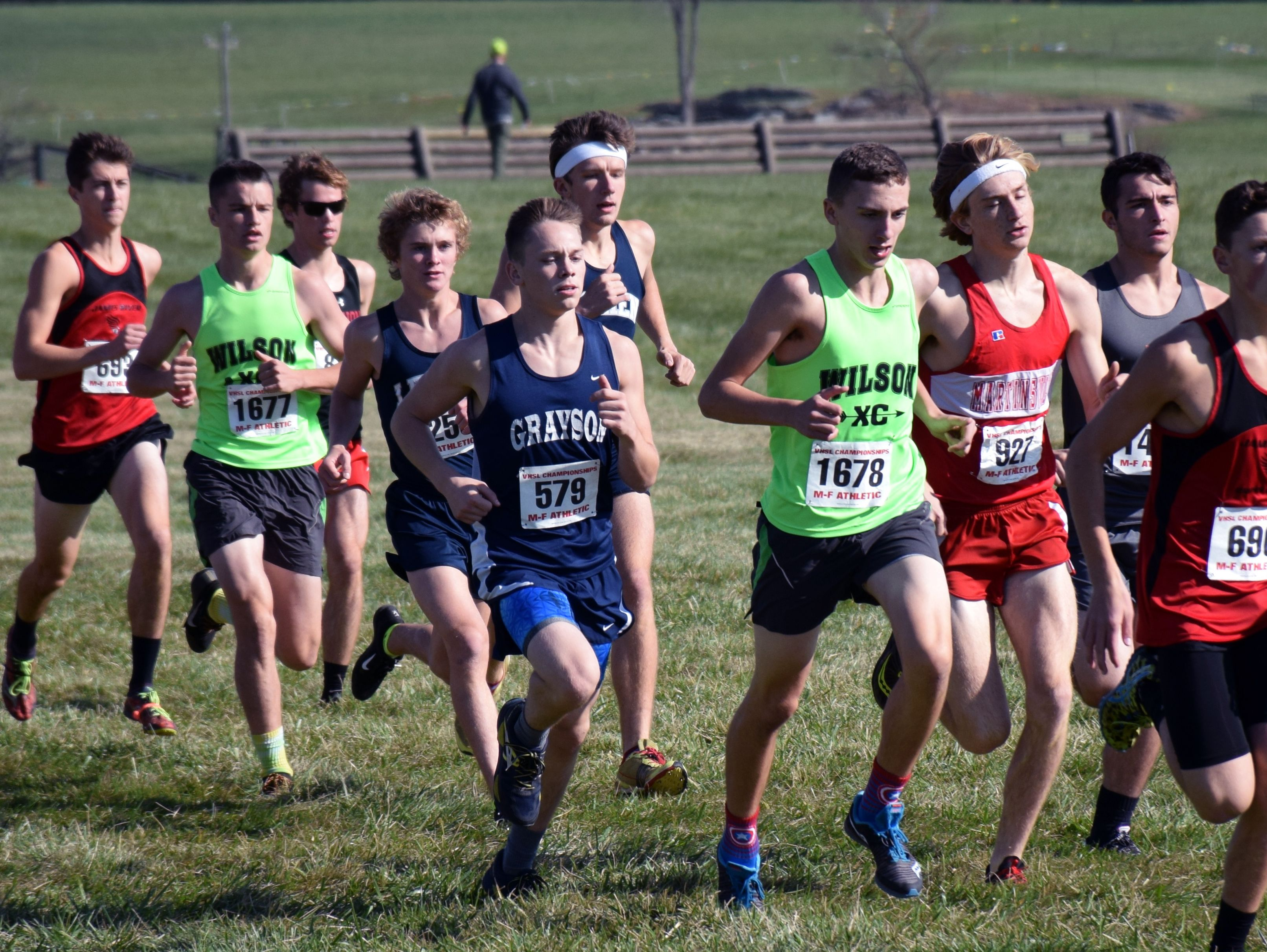 Wilson Memorial's Vincent Leo, right, keeps ahead of Robert E. Lee's Oliver Wilson-Cook and Jacob Warner, center, and teammate Kyle Bryant, left, after the start of the Group 2A boys race at the VHSL cross country championships at Great Meadow in The Plains on Friday, Nov. 11, 2016.