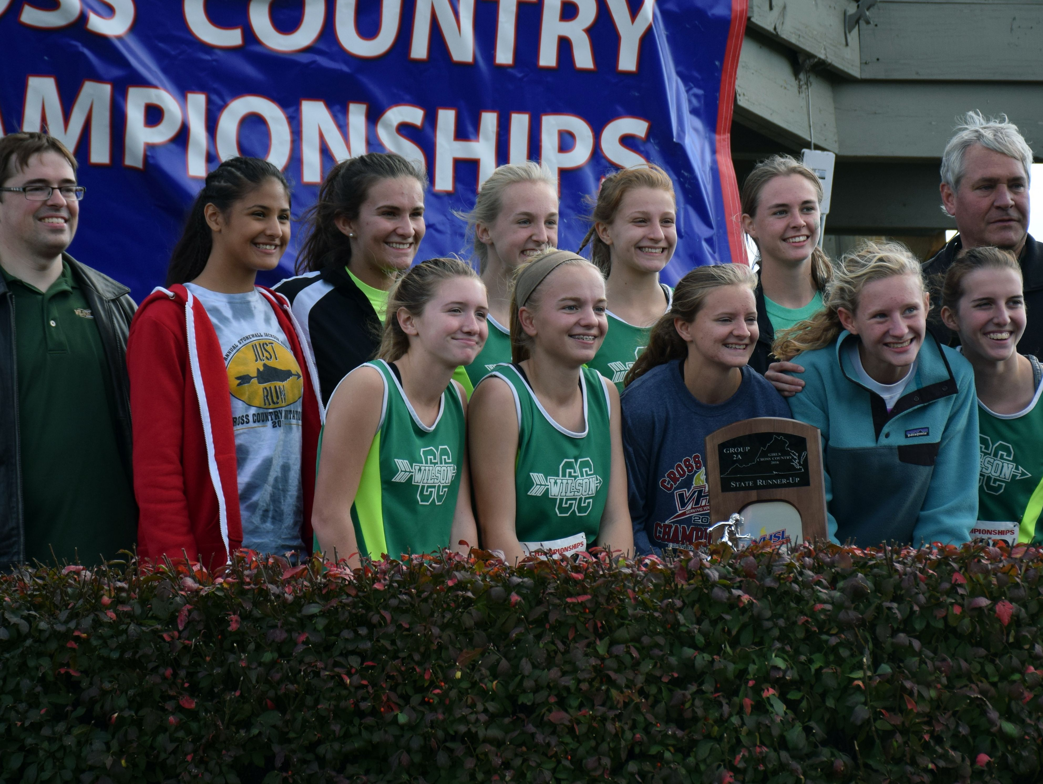 Members of Wilson Memorial's girls team pose with the trophy they received for placing second in the Group 2A girls race at the VHSL cross country championships at Great Meadow in The Plains on Friday, Nov. 11, 2016.