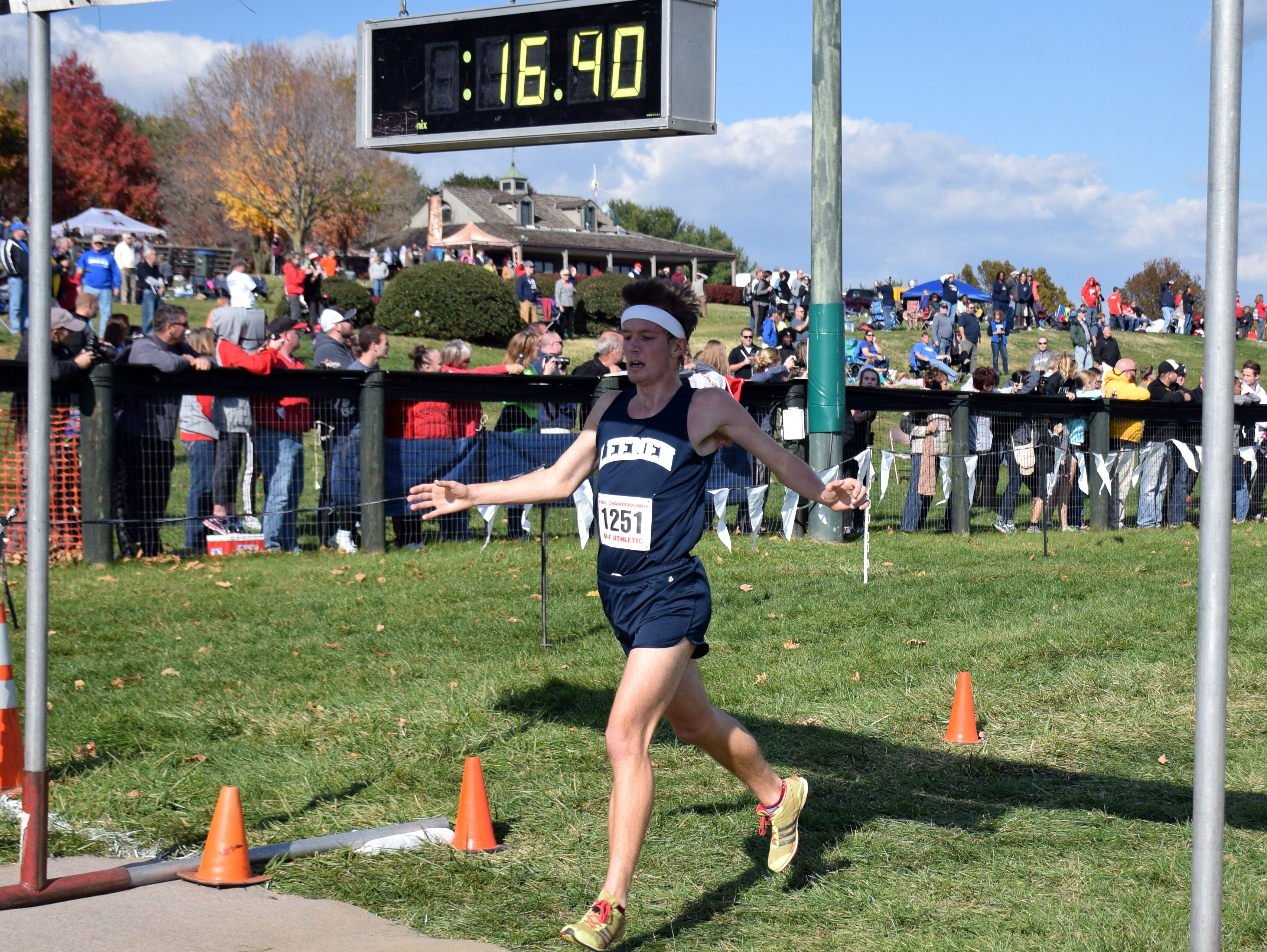 Robert E. Lee's Jacob Warner crosses the finish line of the Group 2A boys race at the VHSL cross country championships at Great Meadow in The Plains on Friday, Nov. 11, 2016.