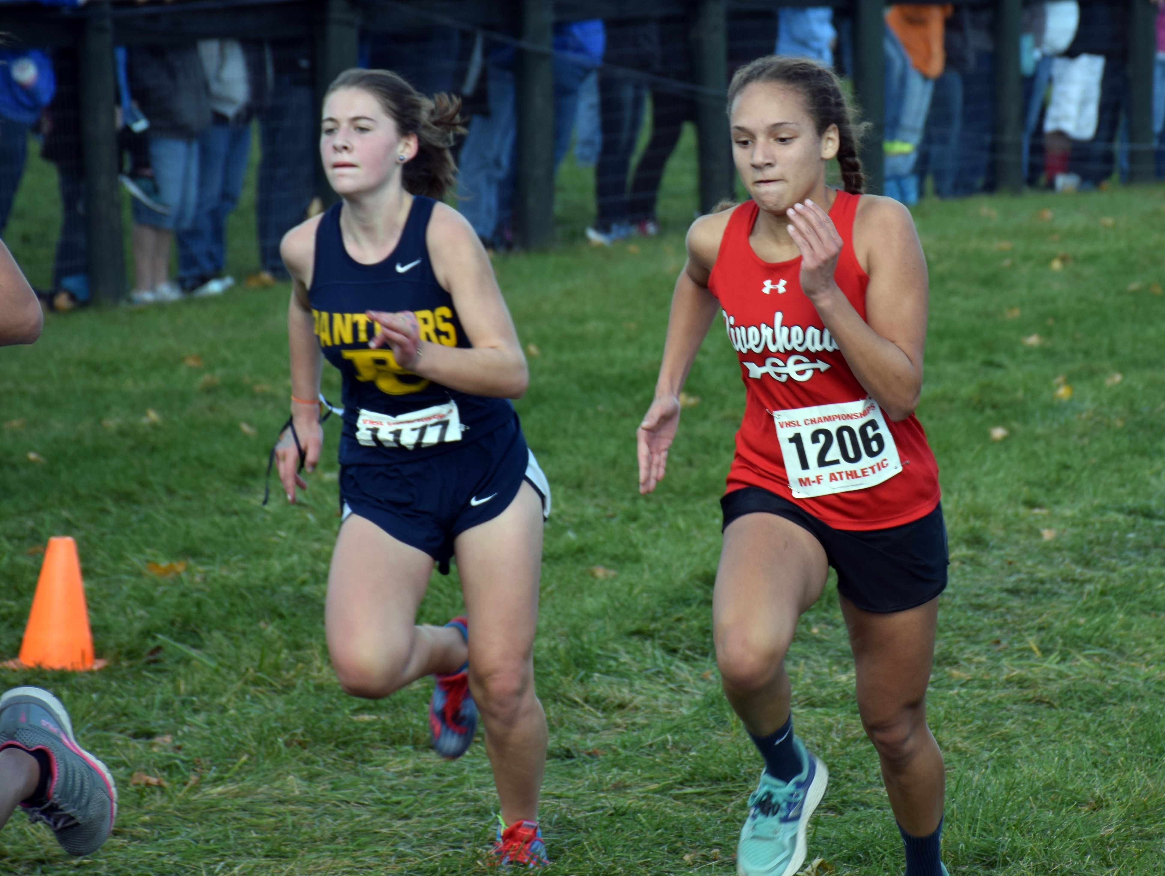 Riverheeads' Veronica Ferguson, right, races Rappahannock County's Skylar Culbertson to the finish line of the Group 1A girls race at the VHSL cross country championships at Great Meadow in The Plains on Friday, Nov. 11, 2016.
