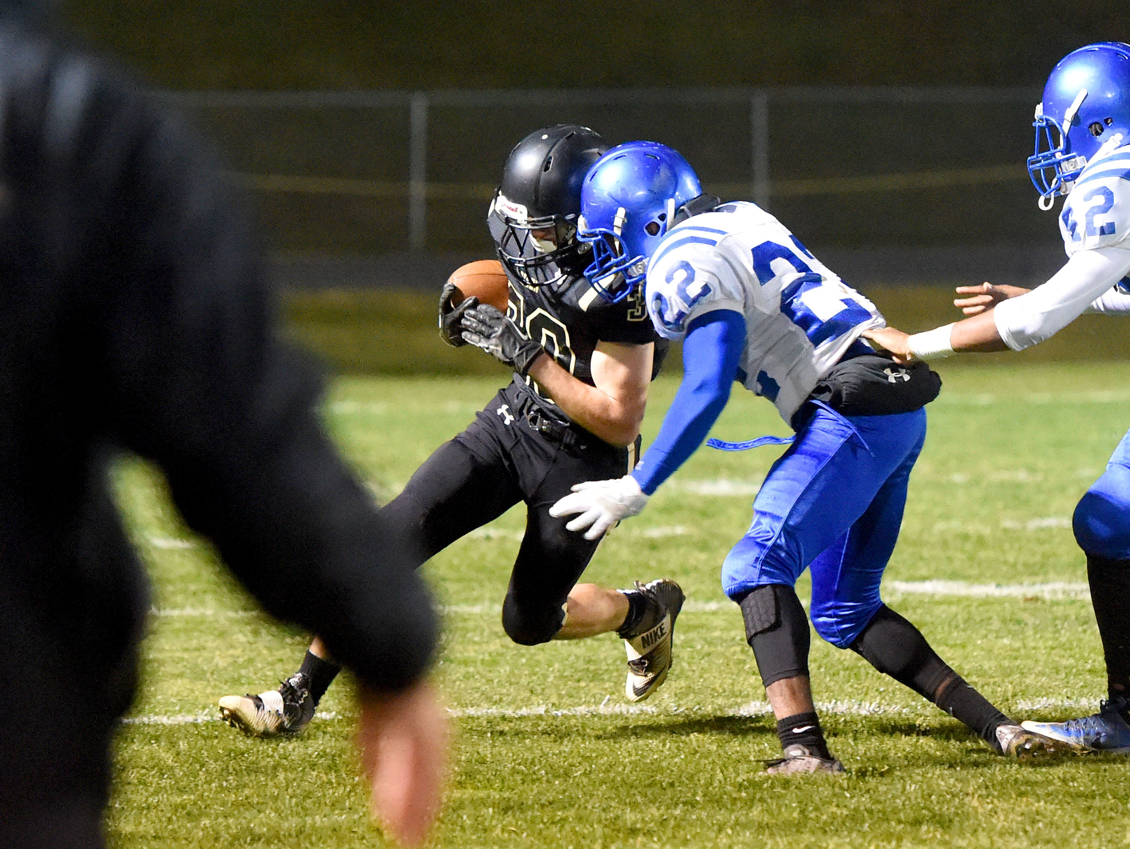 Buffalo Gap's Zach Ingram braces himself with the football as Brunswick's Sharmane Alexander goes for the tackle during a football game played in Swoope on Nov. 11, 2016.