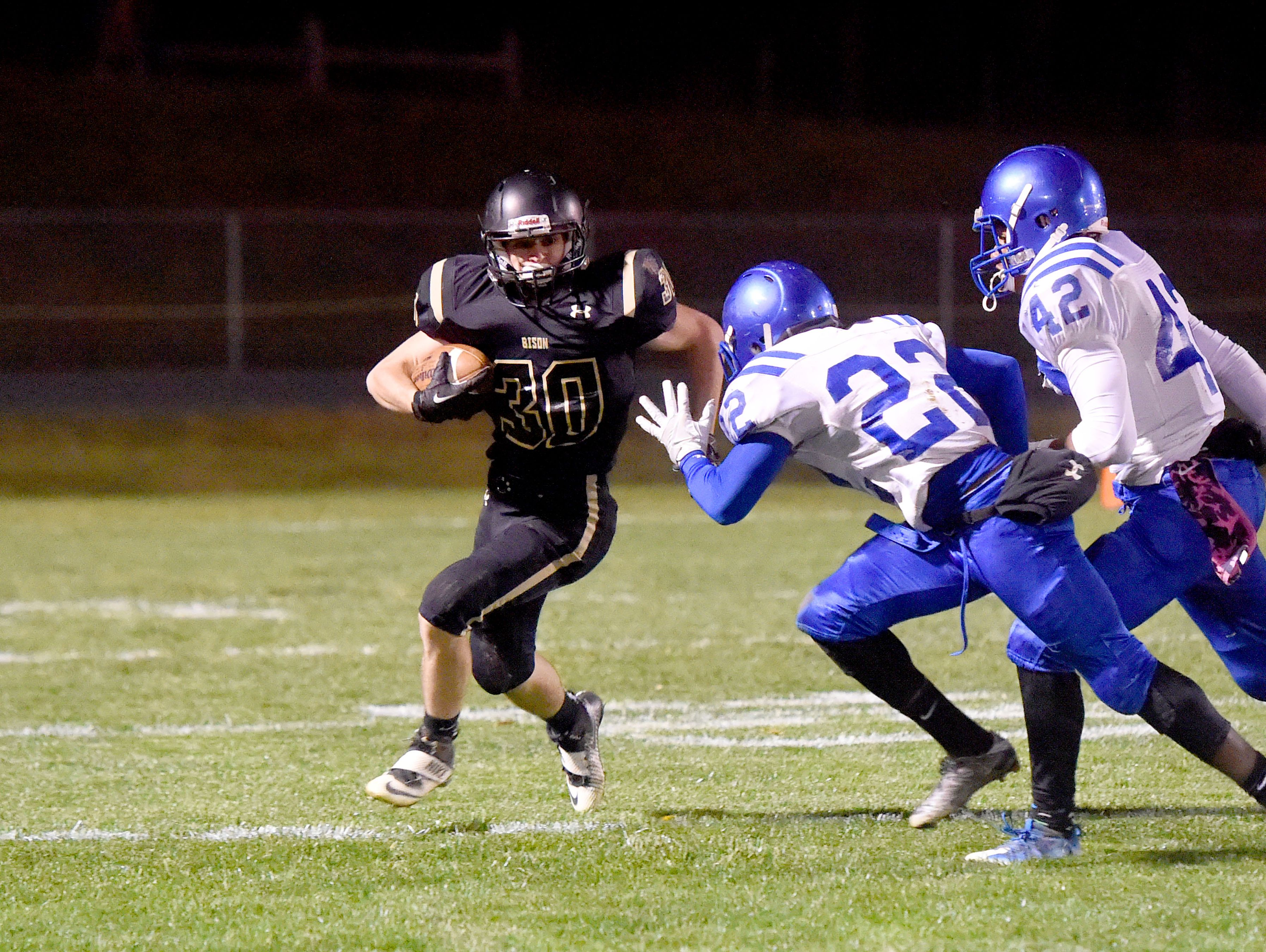 Buffalo Gap's Zach Ingram runs the football as Brunswick's Kwante Rice and Sharmane Alexander close in for the tackle during a football game played in Swoope on Oct. 27, 2016.