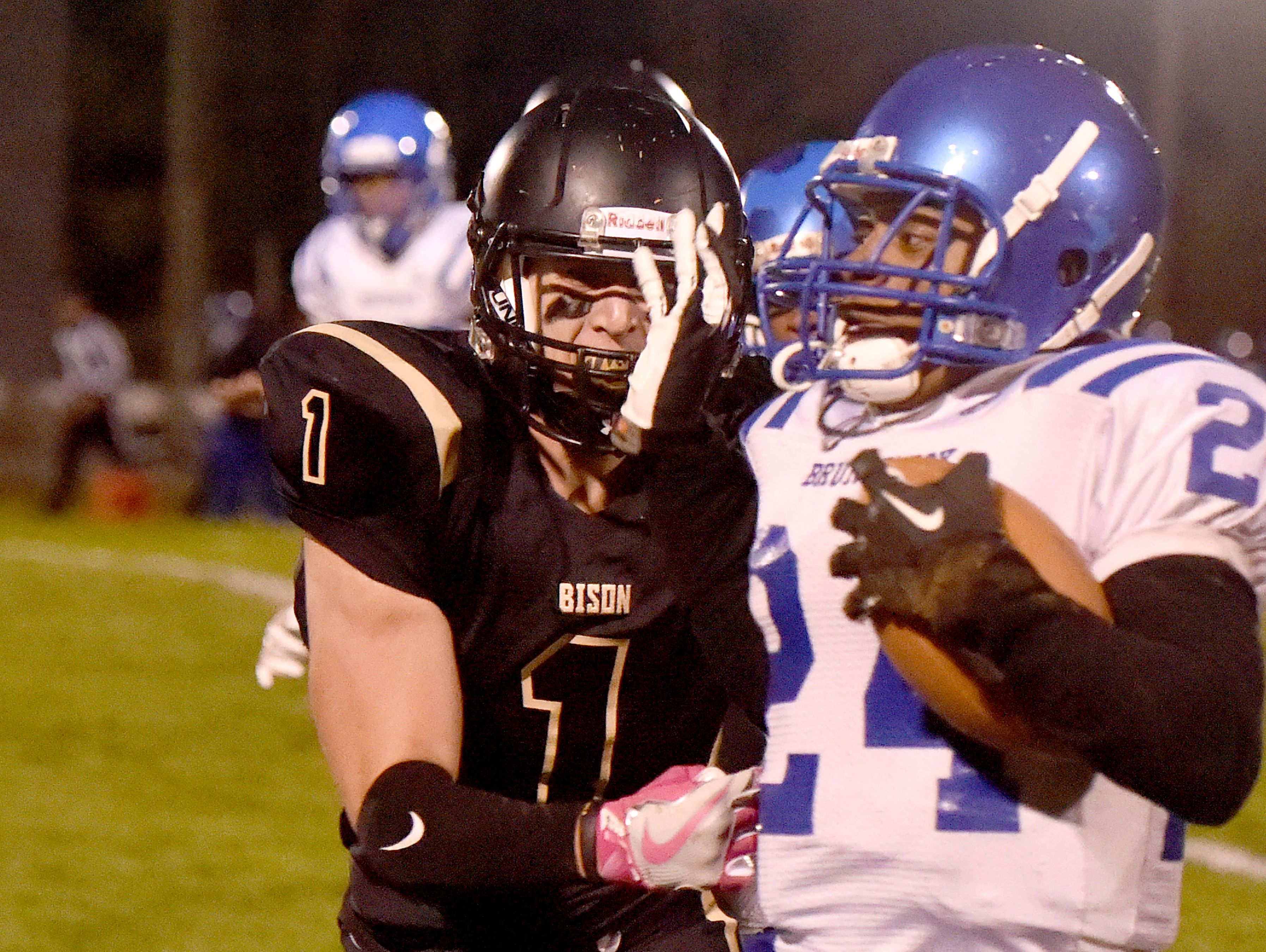 Buffalo Gap's Jake Shelton looks to wrap up Brunswick ball carrier Ahdarius Jackson during a football game played in Swoope on Oct. 27, 2016.