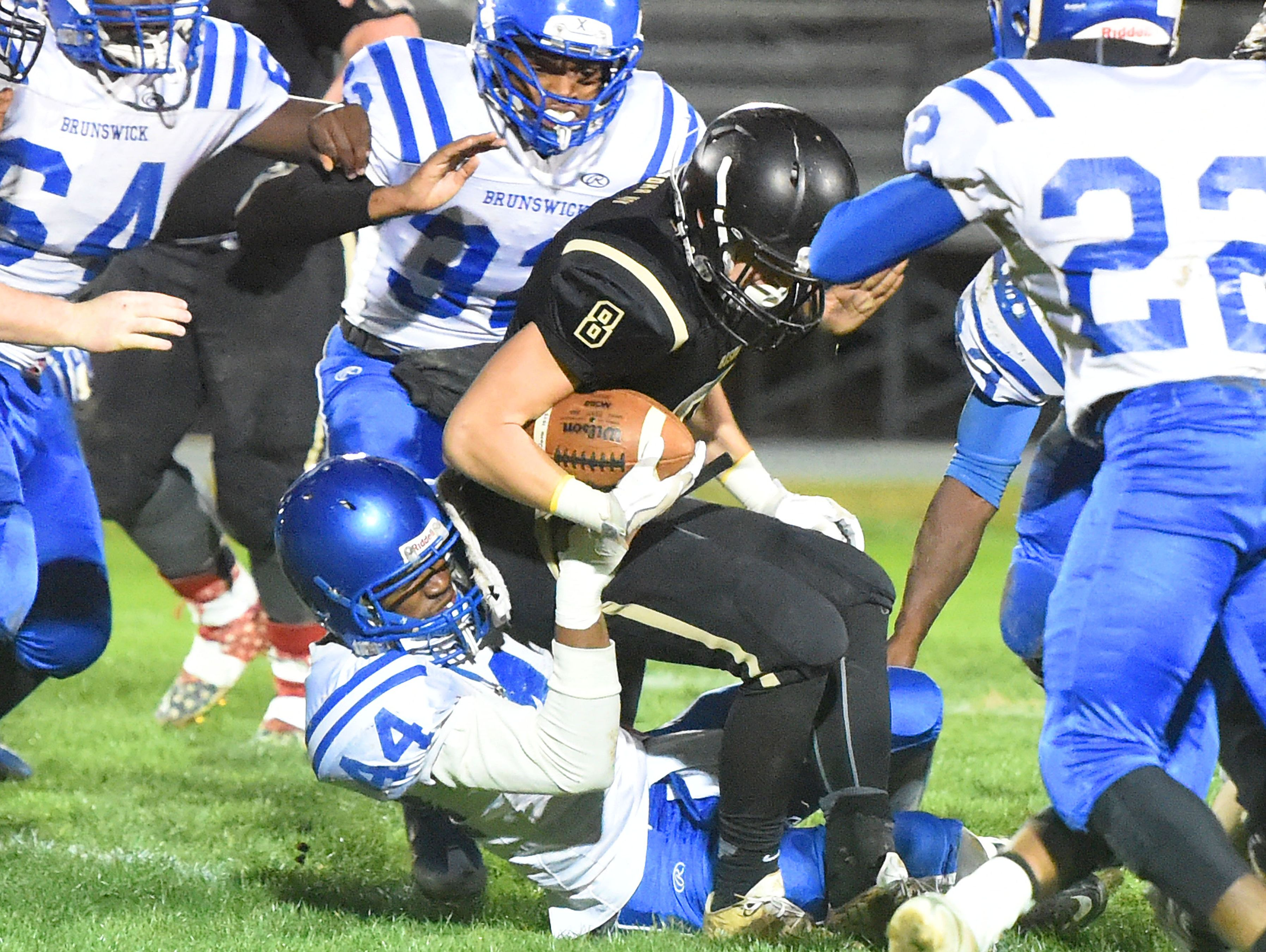 Buffalo Gap's Carter Rivenburg struggles against Brunswick's Marquis Garner who drags him down during a football game played in Swoope on Oct. 27, 2016.