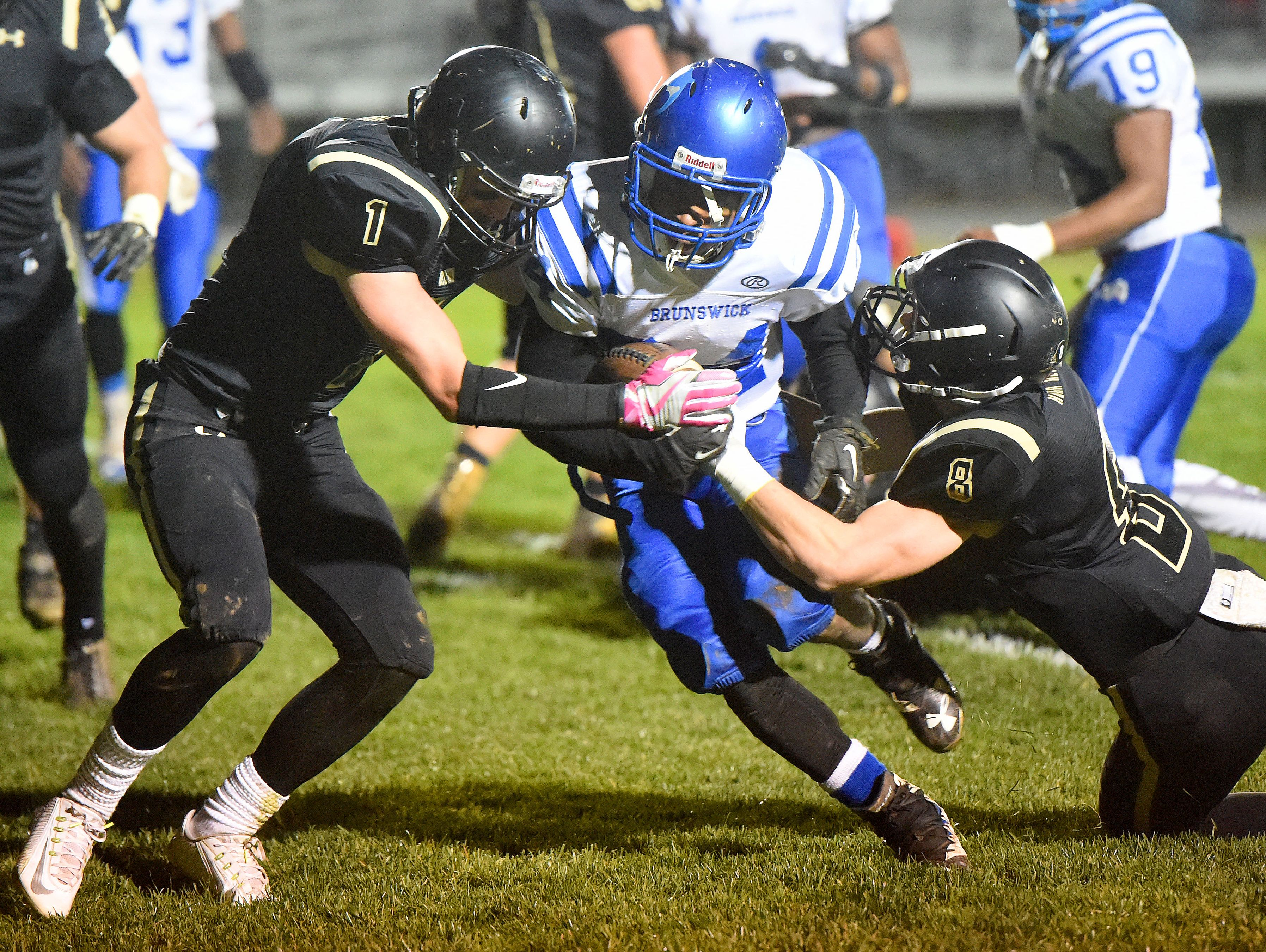 Buffalo Gap's Jake Shelton and Carter Rivenburg catch Brunswick's Ahdarius Jackson between them as they go for the tackle during a football game played in Swoope on Oct. 27, 2016.