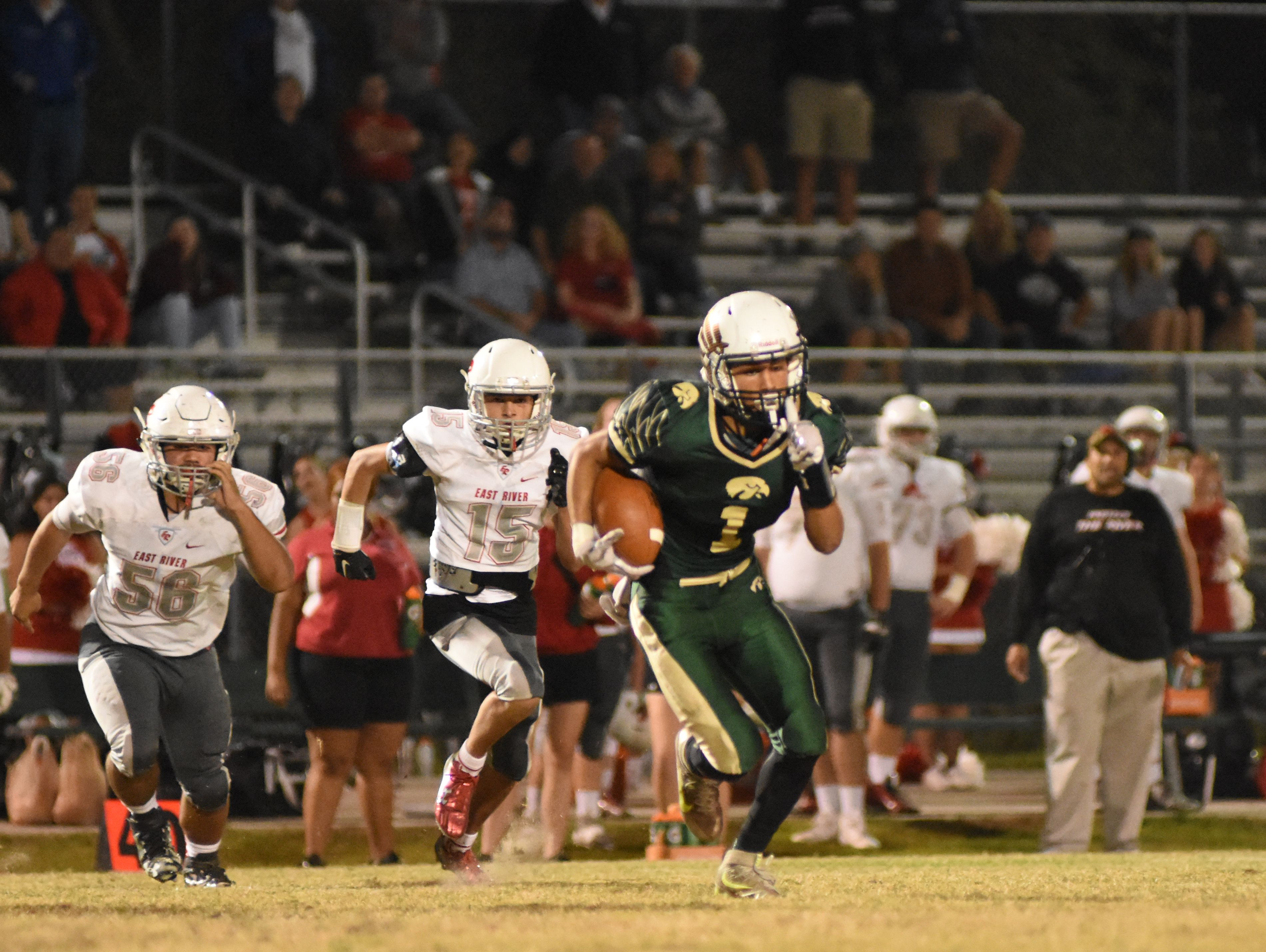 Viera High's Travis Jones (1) is pursued by East River's Bryce Weir (15) and Isaias Poche (50).