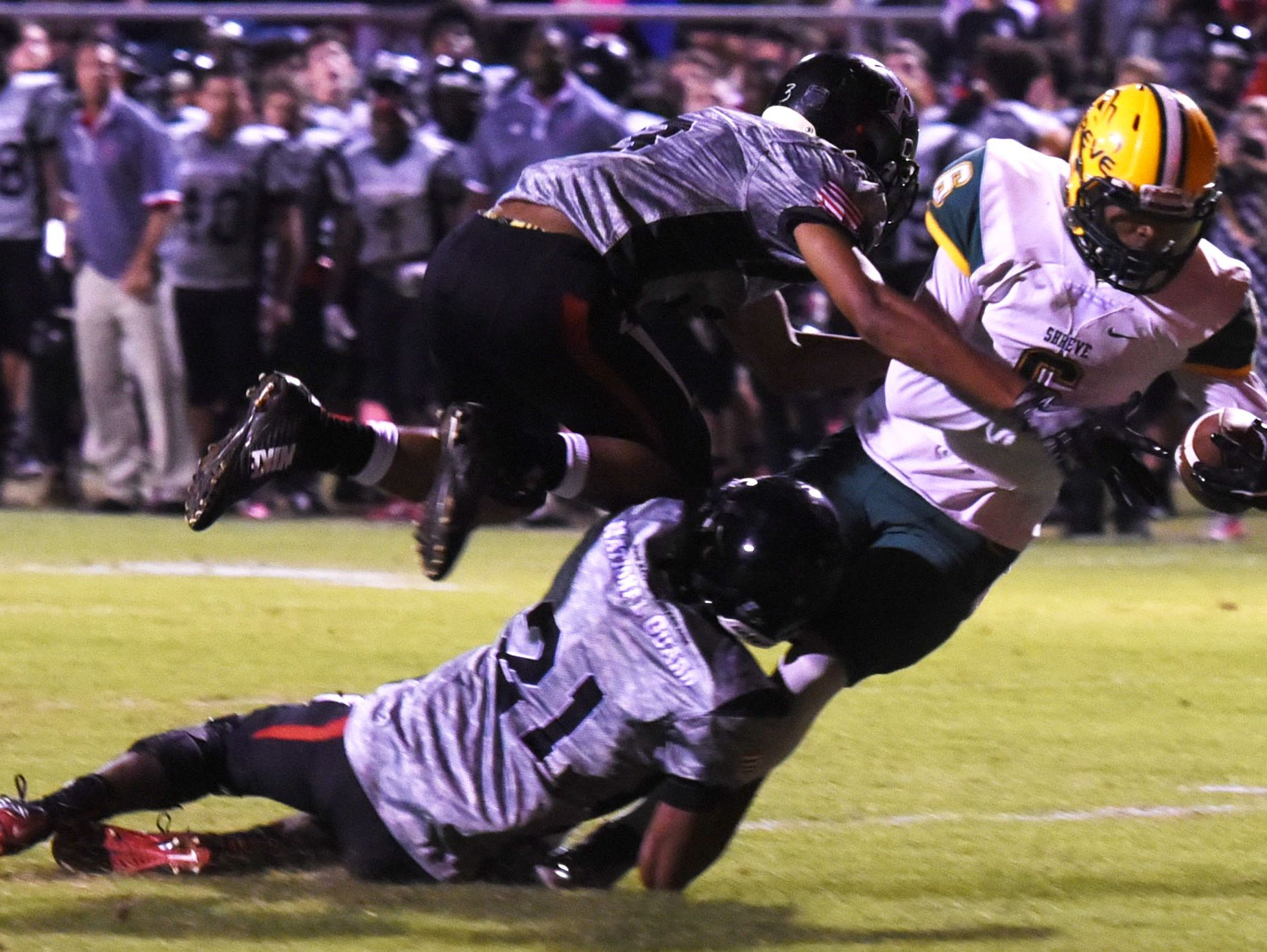 Captain Shreve's Corey Milligan tries to get past Parkway's defense Friday evening at Preston Crownover Stadium.