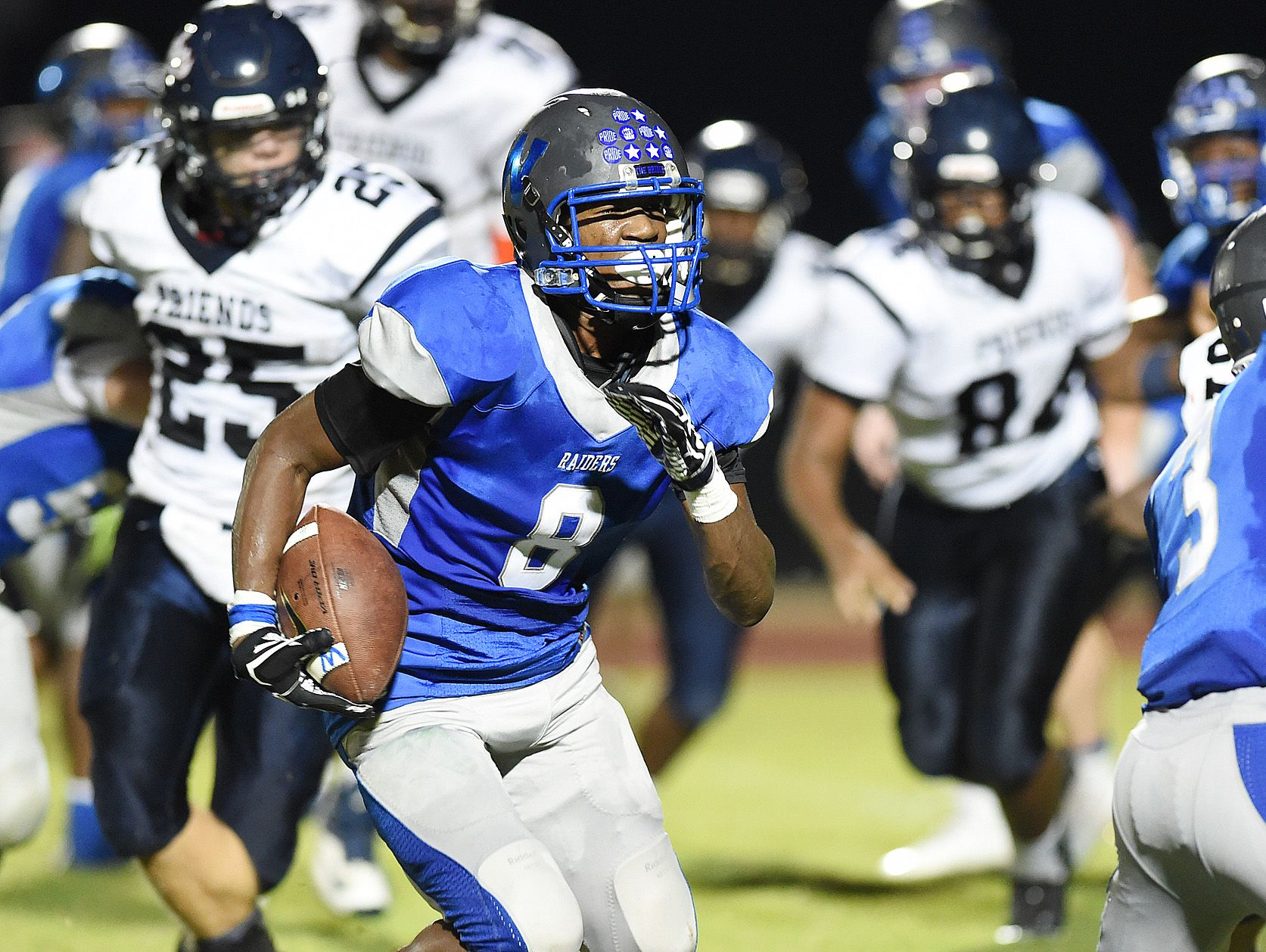 Woodbridge's Jamon Kane, seen here against Wilmington Friends, ran for two rushing touchdowns as the Blue Raiders ended the regular season 10-0 with a 3907 win over Delmar on Friday.