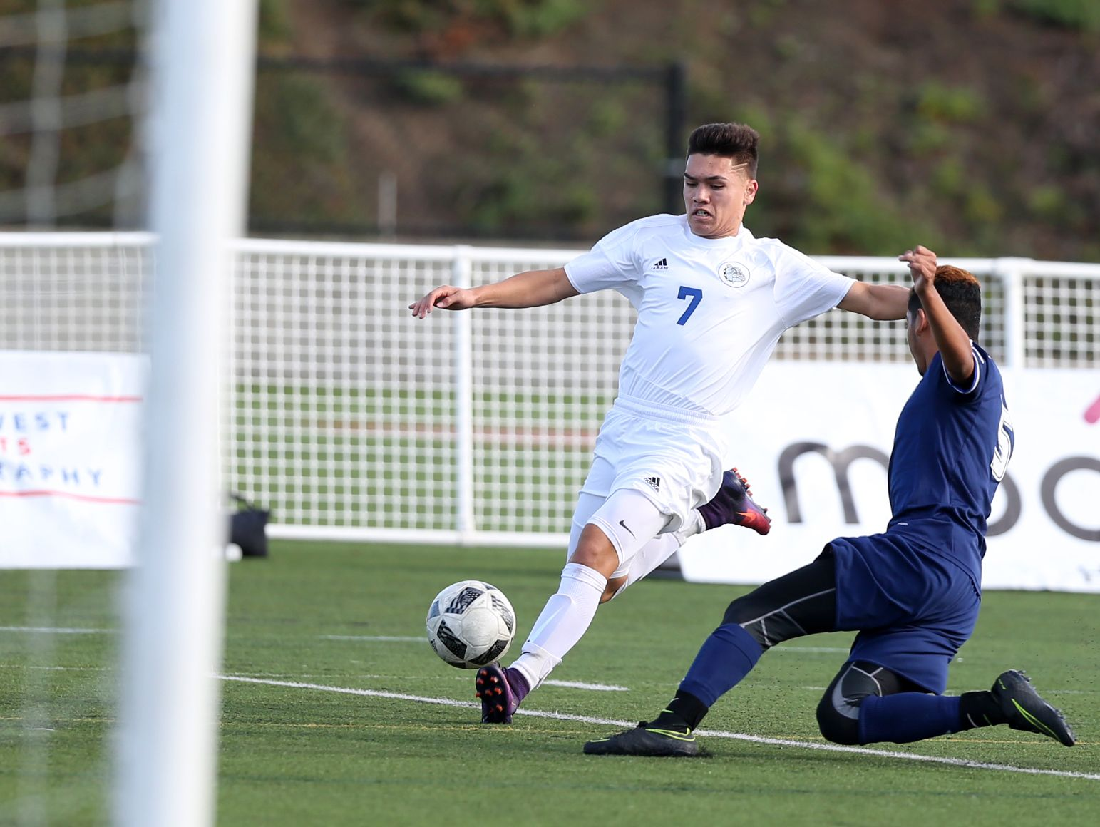 Wilsonville's Carlos Ulloa tries to block a kick by Woodburn's Conner Karsseboom as the Bulldogs defeat Wilsonville 1-0 to win OSAA Class 5A State Championship on Saturday, Nov. 12, 2016, at Hillsboro Stadium.