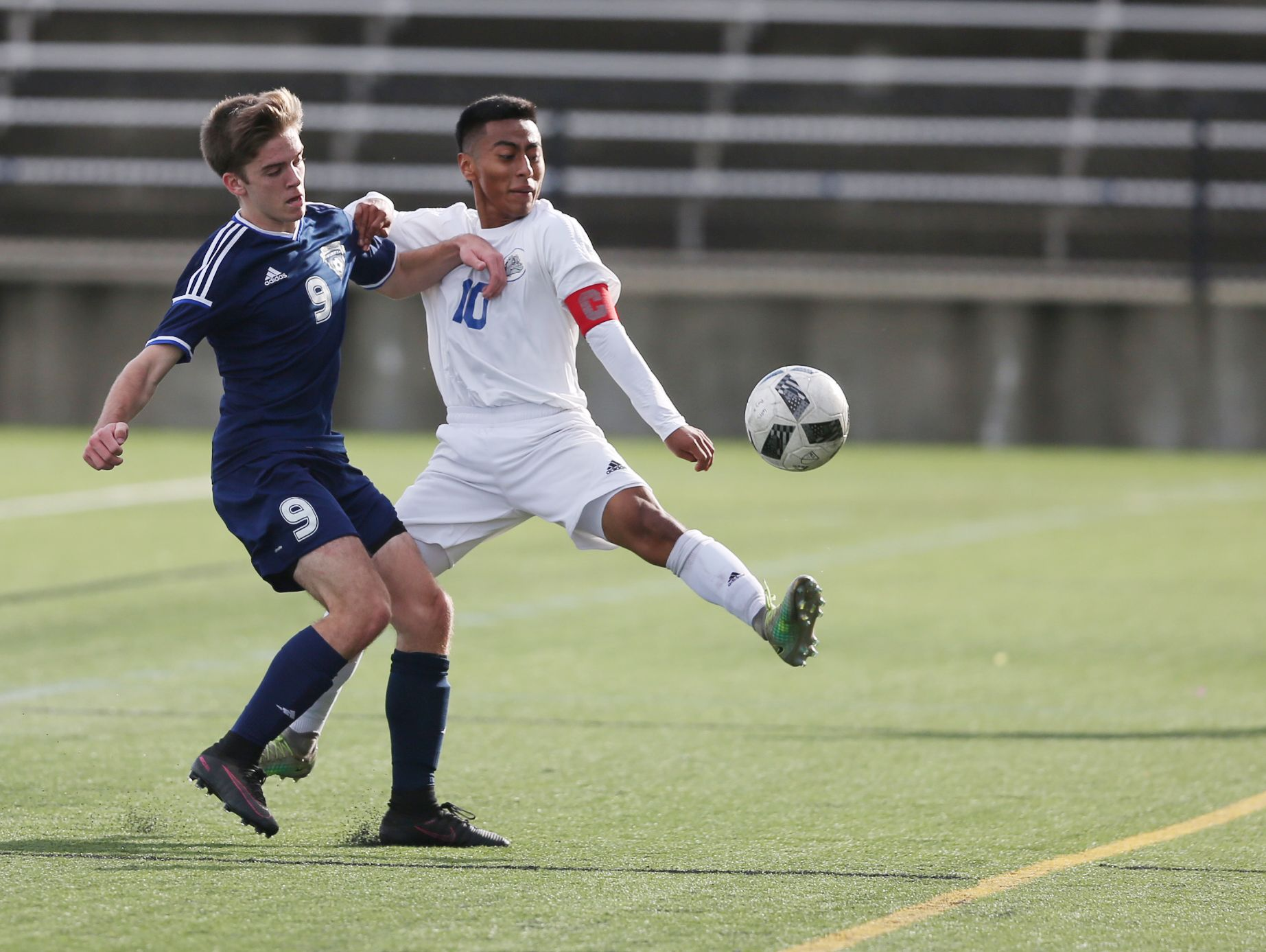 Woodburn's Kevin Vasquez and Wilsonville's Riley King battle for the ball as the Bulldogs defeat Wilsonville 1-0 to win OSAA Class 5A State Championship on Saturday, Nov. 12, 2016, at Hillsboro Stadium.