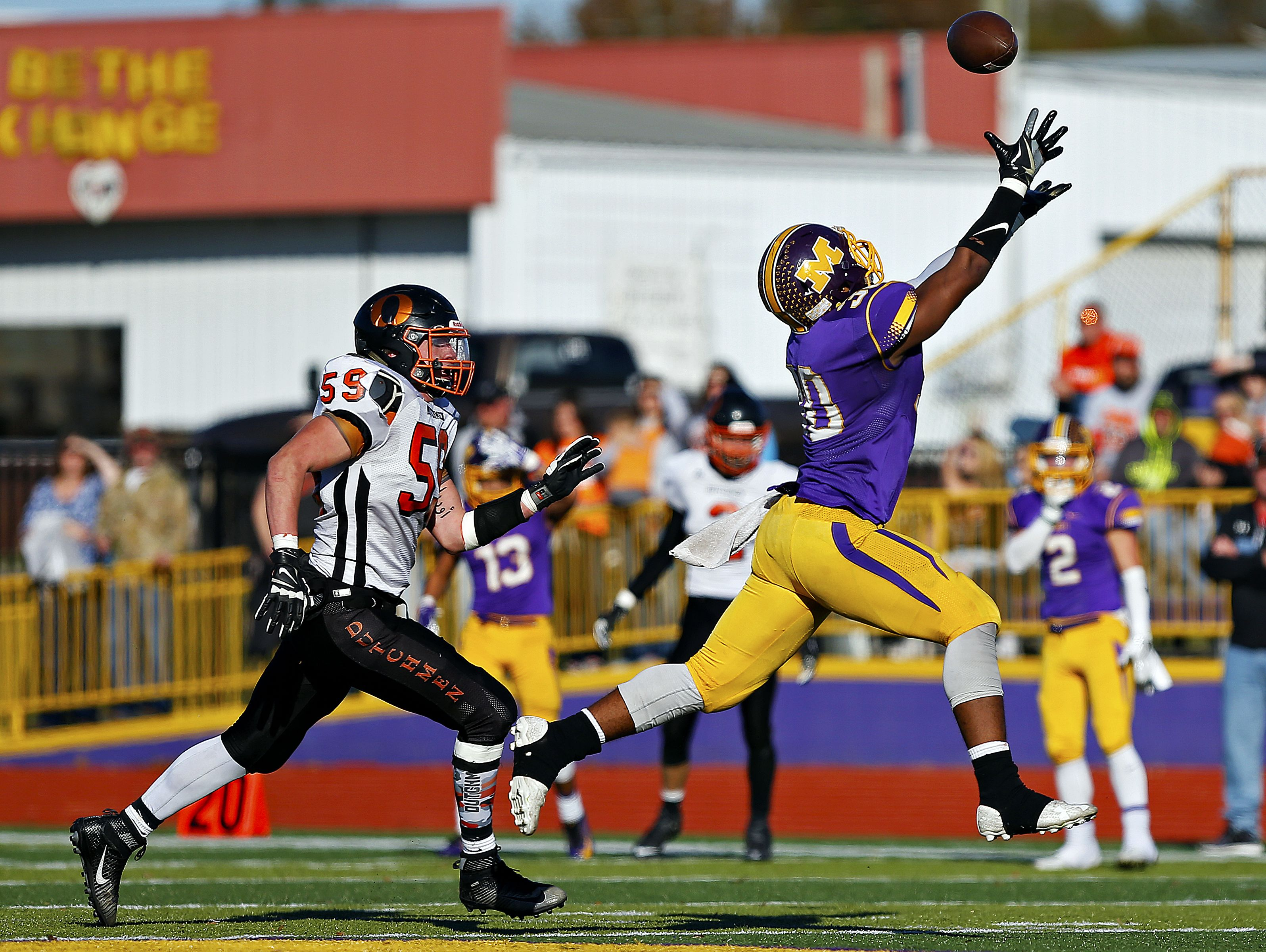 Monett High School running back Michael Branch (30) reaches to catch a pass during third quarter action of the quarterfinal playoff game between Monett High School and Owensville High School played at Burl Fowler Stadium in Monett, Mo. on Nov. 12, 2016. The Monett Cubs won the game 48-20.