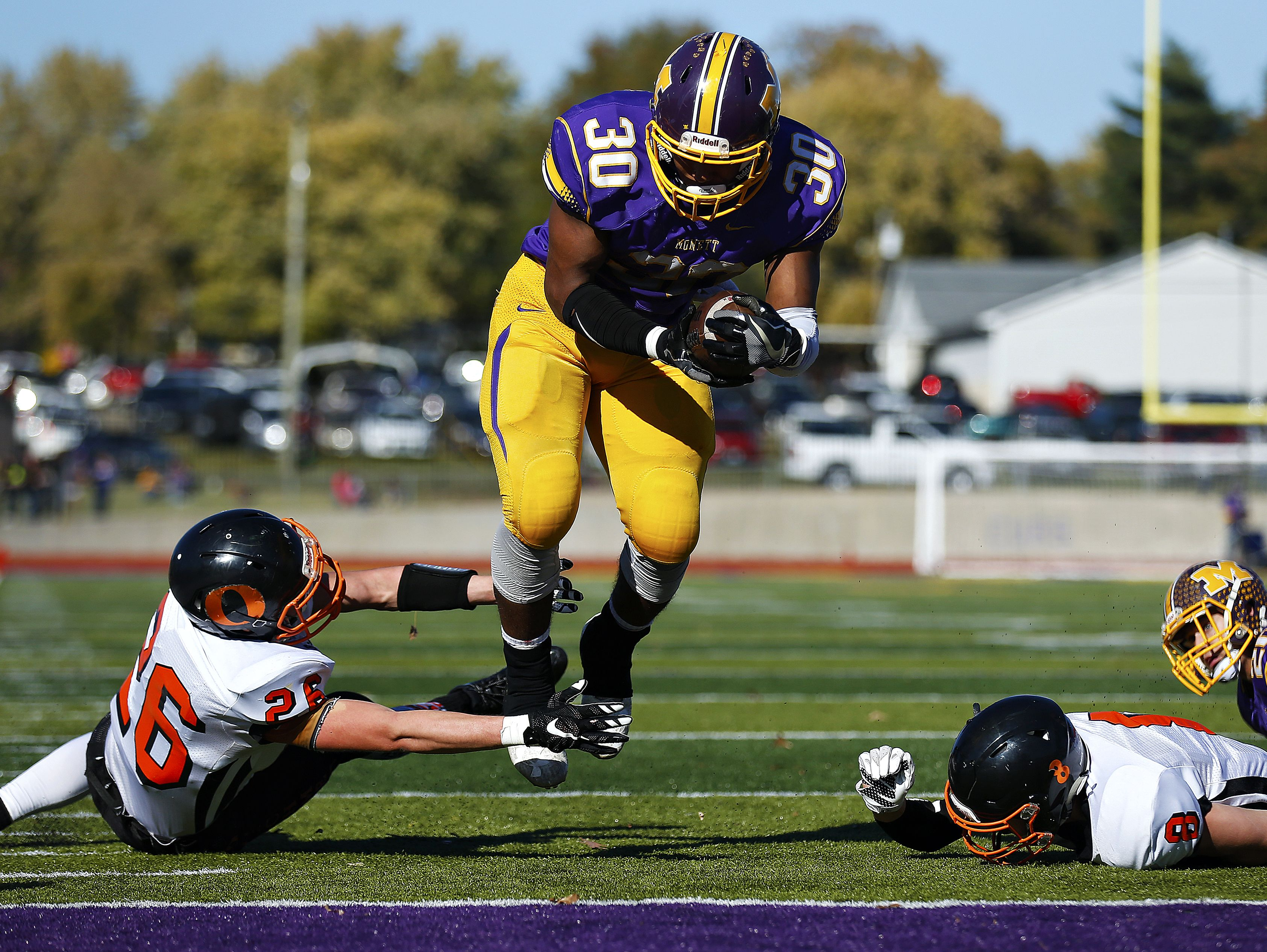 Monett High School running back Michael Branch (30) leaps and stretches into the end zone to score a touchdown during second quarter action of the quarterfinal playoff game between Monett High School and Owensville High School played at Burl Fowler Stadium in Monett, Mo. on Nov. 12, 2016. The Monett Cubs won the game 48-20.
