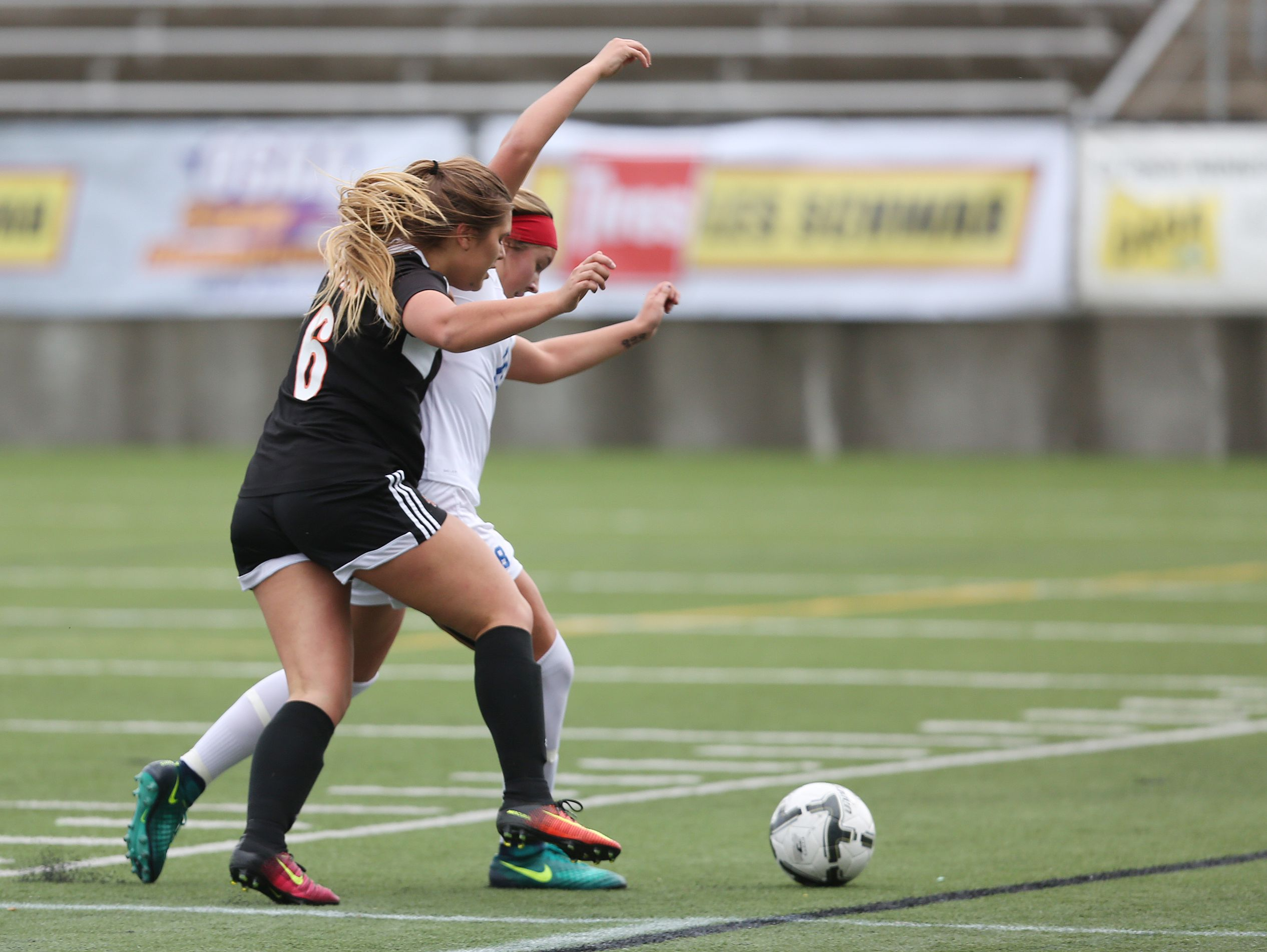 Silverton's Maddy Valoff and La Salle's Ellie Gentry battle for the ball as the Foxes fall to La Salle 3-2 in overtime during the OSAA Class 5A State Championship game on Saturday, Nov. 12, 2016, at Hillsboro Stadium.