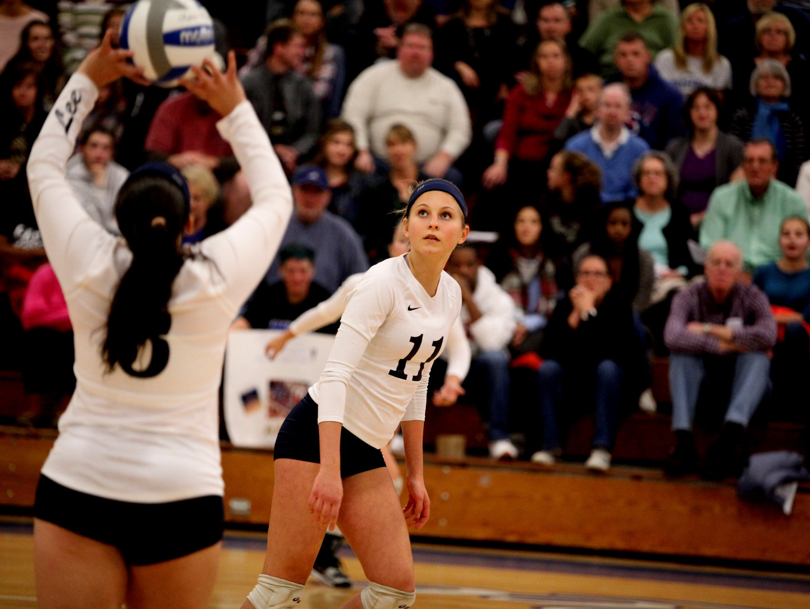 Lee's Addison Keatts prepares to spike a ball set by Amber Johnson during the 2A girls volleyball championship at R.E. Lee High School in Staunton on Saturday Nov. 12, 2016.