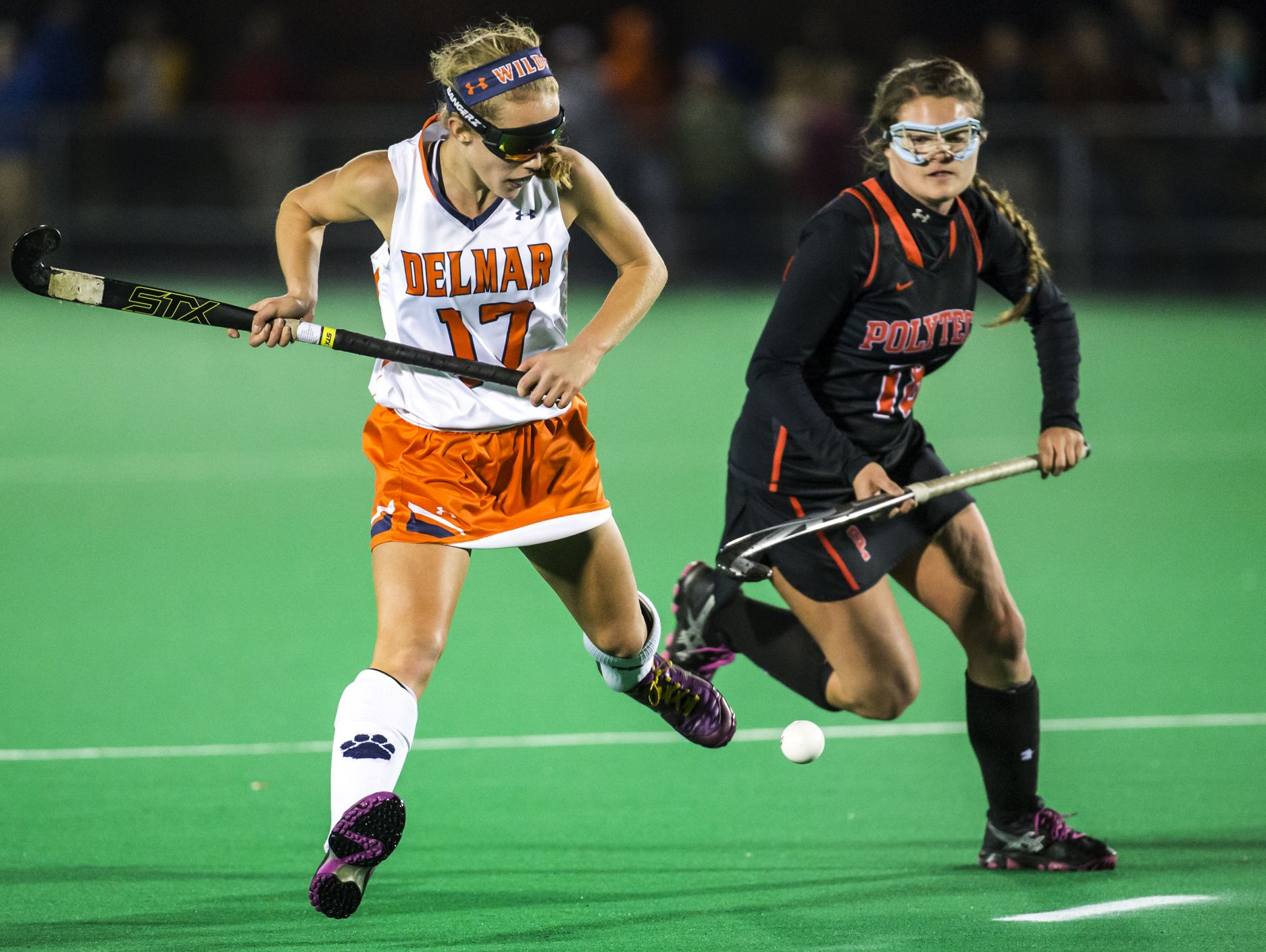 Delmar's Ashlyn Carr (left) and Polytech's Meadow Watkinson (right) chase down the ball in the second half of Delmar's 2-0 win over Polytech in their DIAA state tournament semi-final game at the University of Delaware in Newark on Tuesday night.