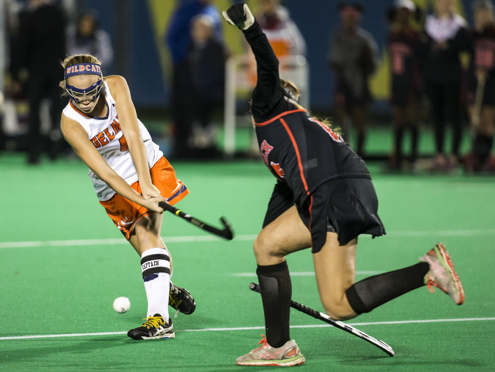 Delmar's Peyton Kemp (left) puts a shot on goal in the first half of Delmar's 2-0 win over Polytech in their DIAA state tournament semi-final game at the University of Delaware in Newark on Tuesday night.