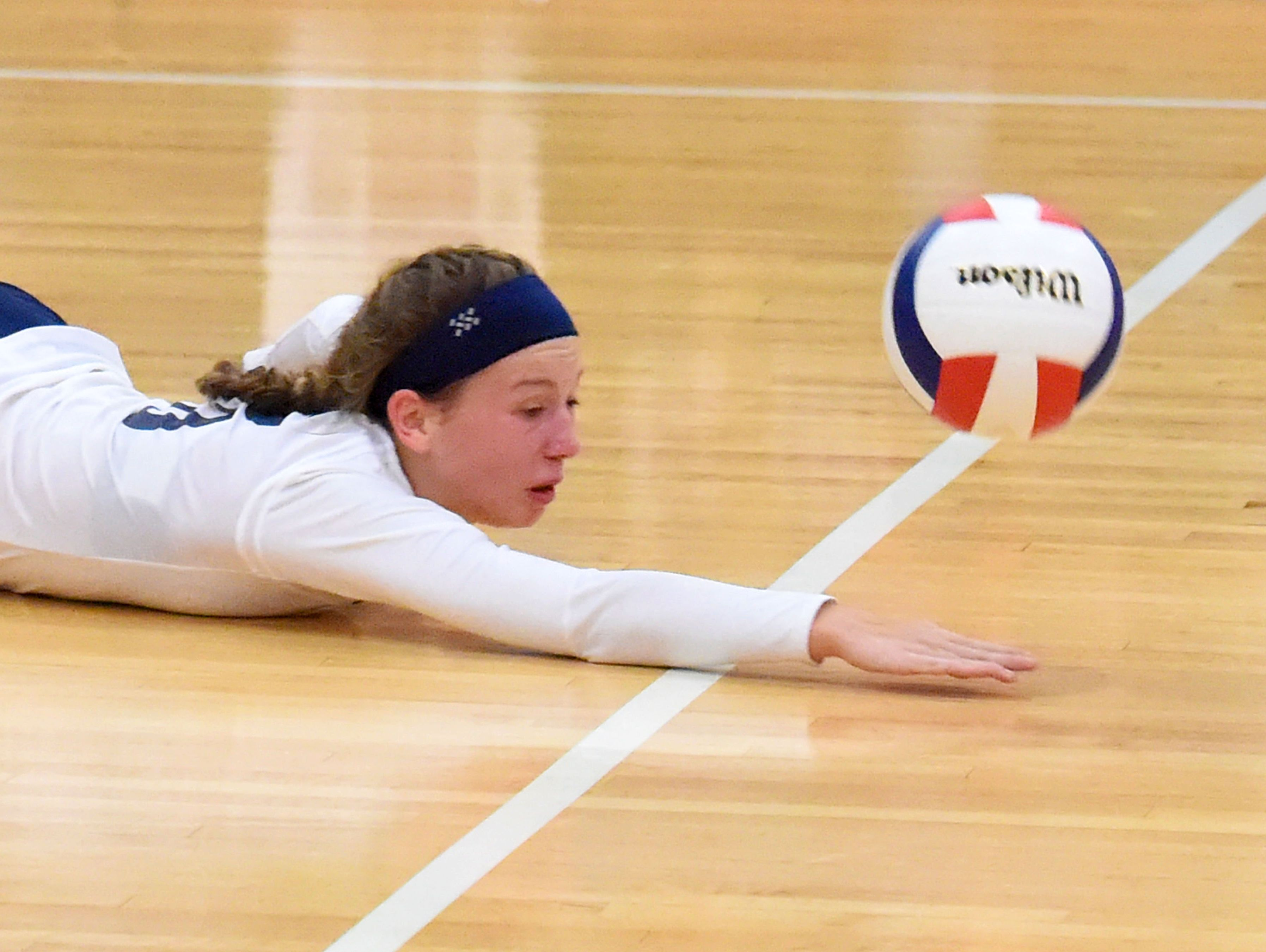 Robert E. Lee's Meghan Wood just misses diving after the ball during a volleyball game played in Staunton on Tuesday, Nov. 15, 2016. Lee High beat Giles High School to win the 2A state semifinal match, 3-1.