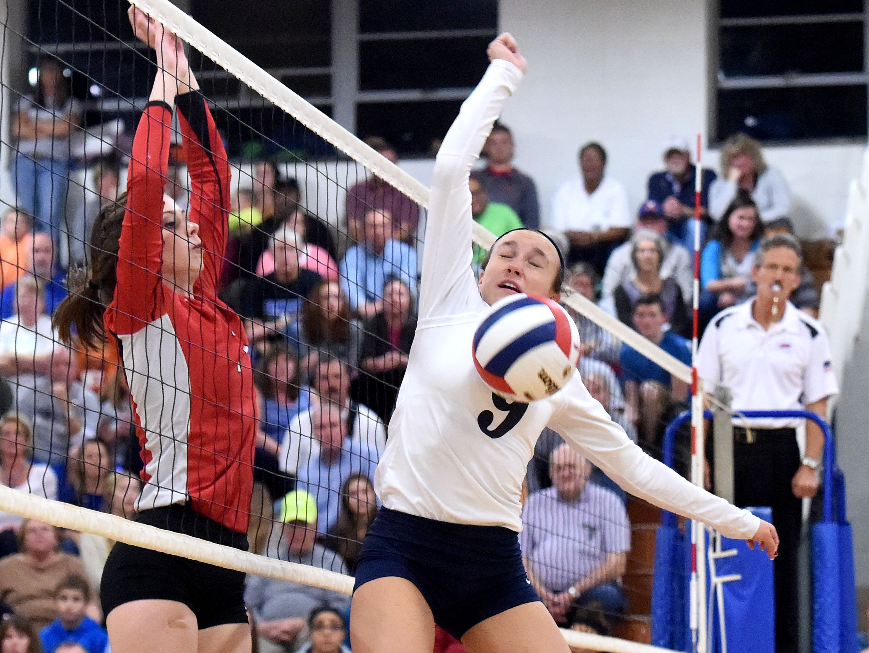 Robert E. Lee's Camryn Shull is blocked at the net during a volleyball game played in Staunton on Tuesday, Nov. 15, 2016. Lee High beat Giles High School to win the 2A state semifinal match, 3-1.