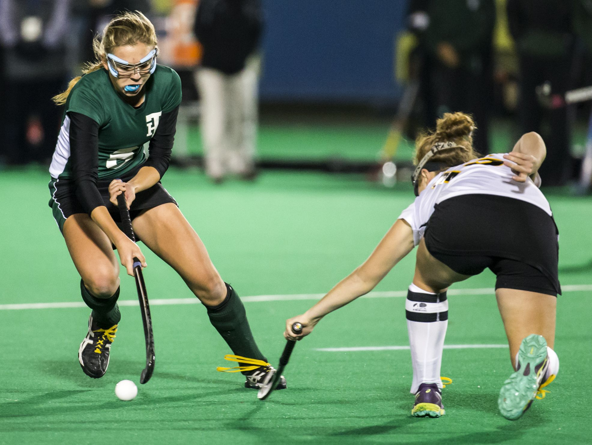 Tower Hill's Isabelle Pilson (left) cuts past Padua's Susan Stepek (right) in the second half of Tower Hill's 4-0 win over Padua in their DIAA state tournament semi-final game at the University of Delaware in Newark on Tuesday night.