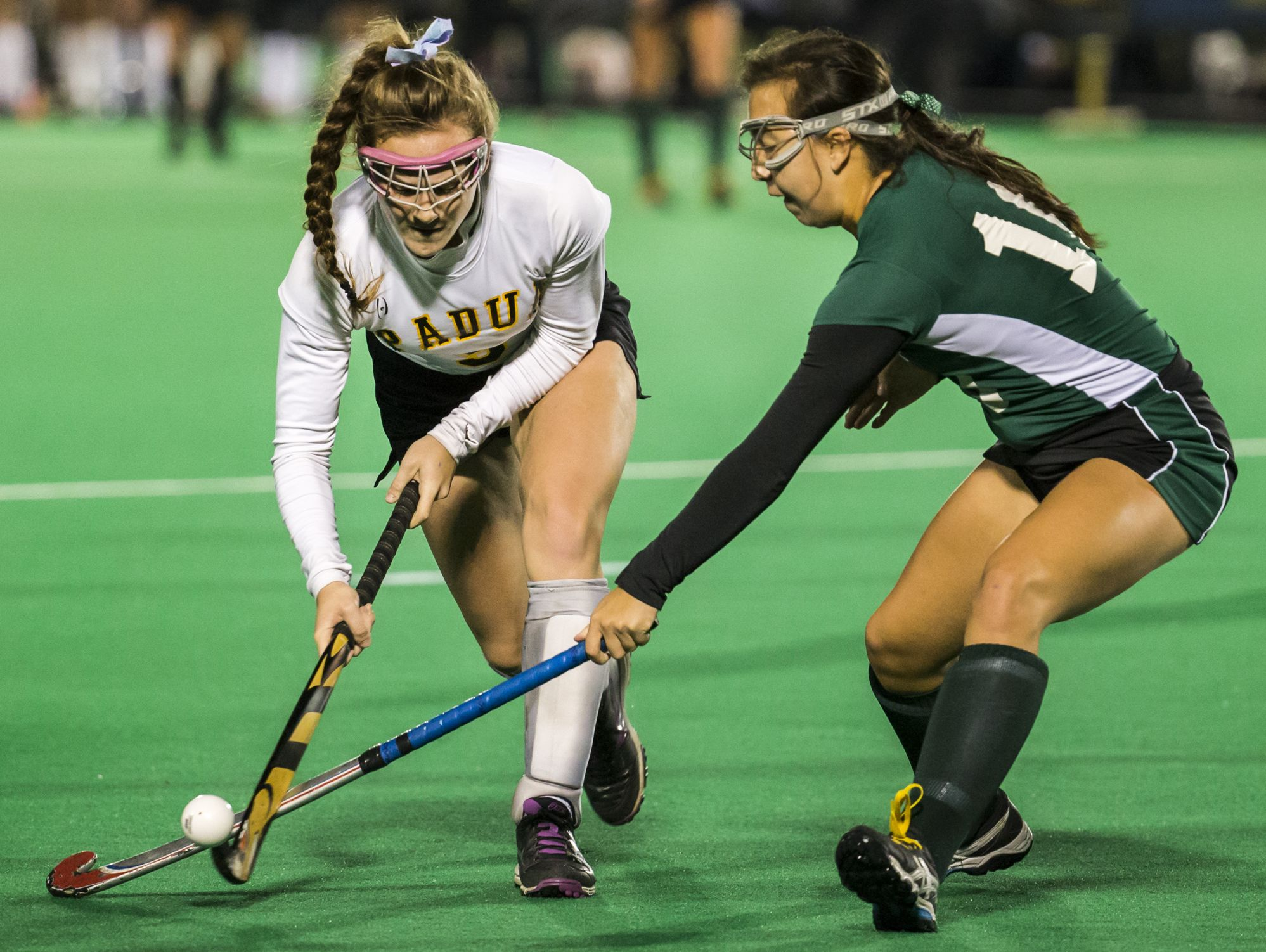 Padua's Kathleen Melia (left) tries to work past Tower Hill's Julia Smith (right) in the first half of Tower Hill's 4-0 win over Padua in their DIAA state tournament semi-final game at the University of Delaware in Newark on Tuesday night.