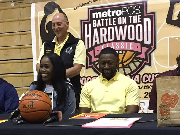 Speaking at Wednesday's news conference for the Battle on the Hardwood Classic were (seated) Mack Jones, Cherise Sims, Eddie Hamilton and LeAndre Gipson. Standing is Fair Park principal Brude Dagle.