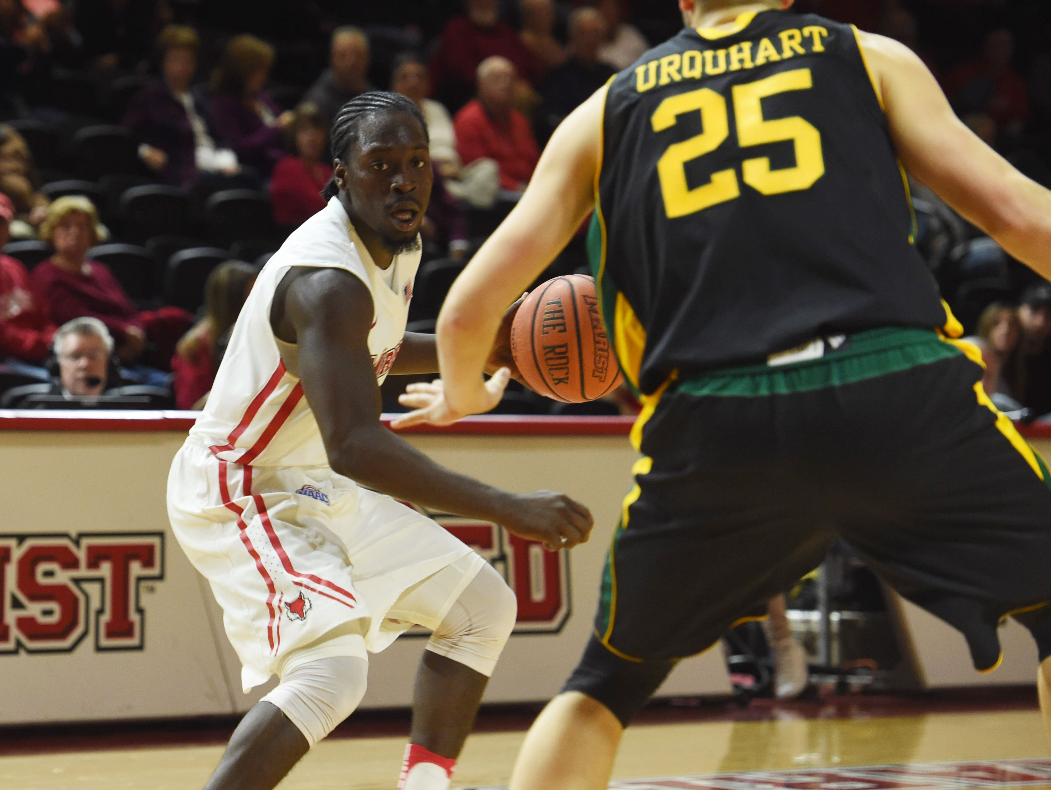 Marist's Khallid Hart looks for an open teammate during Wednesday's home opener against Vermont.
