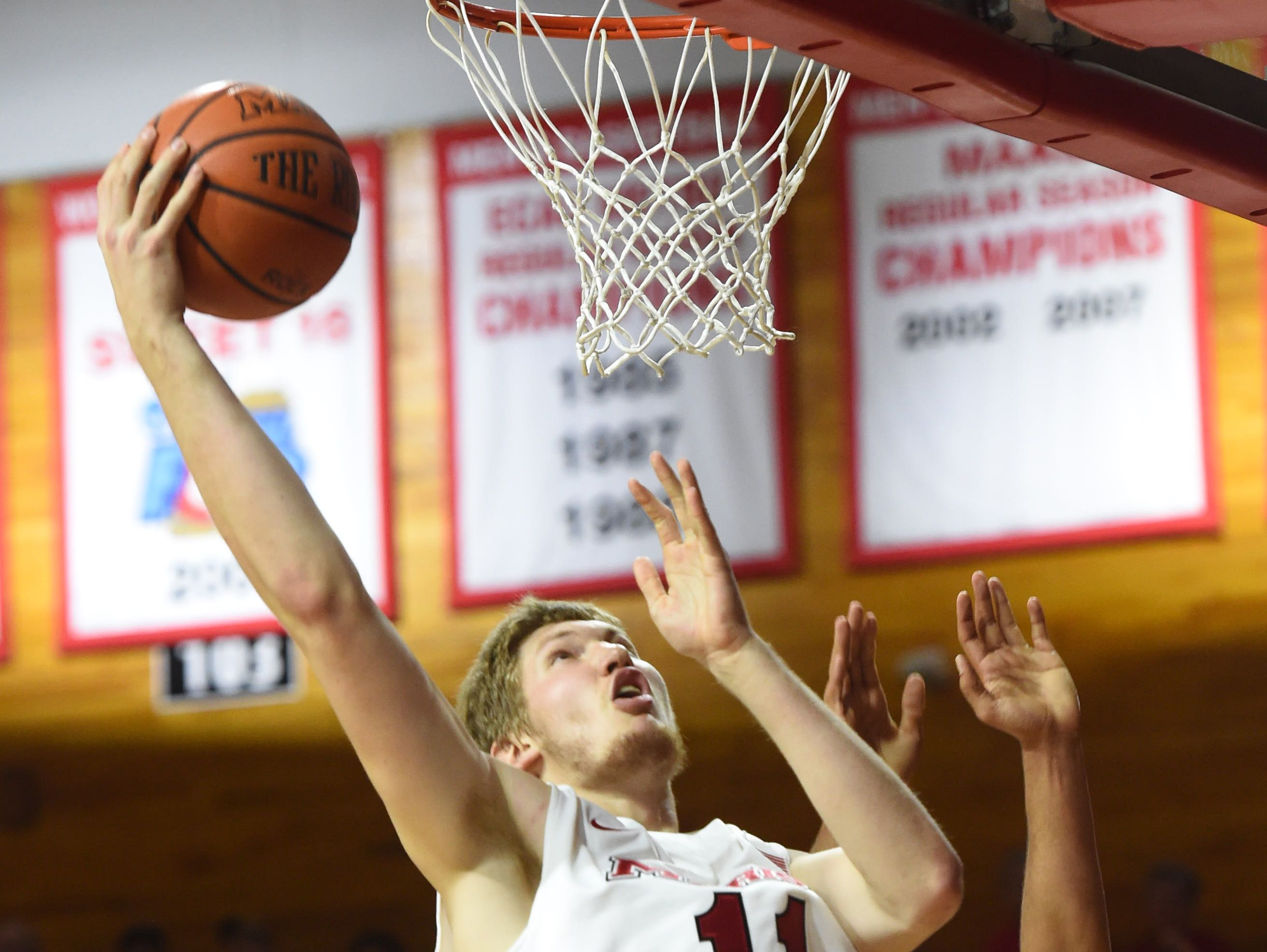 Marist's Tobias Sjoberg goes for a layup during Wednesday's home opener against Vermont.