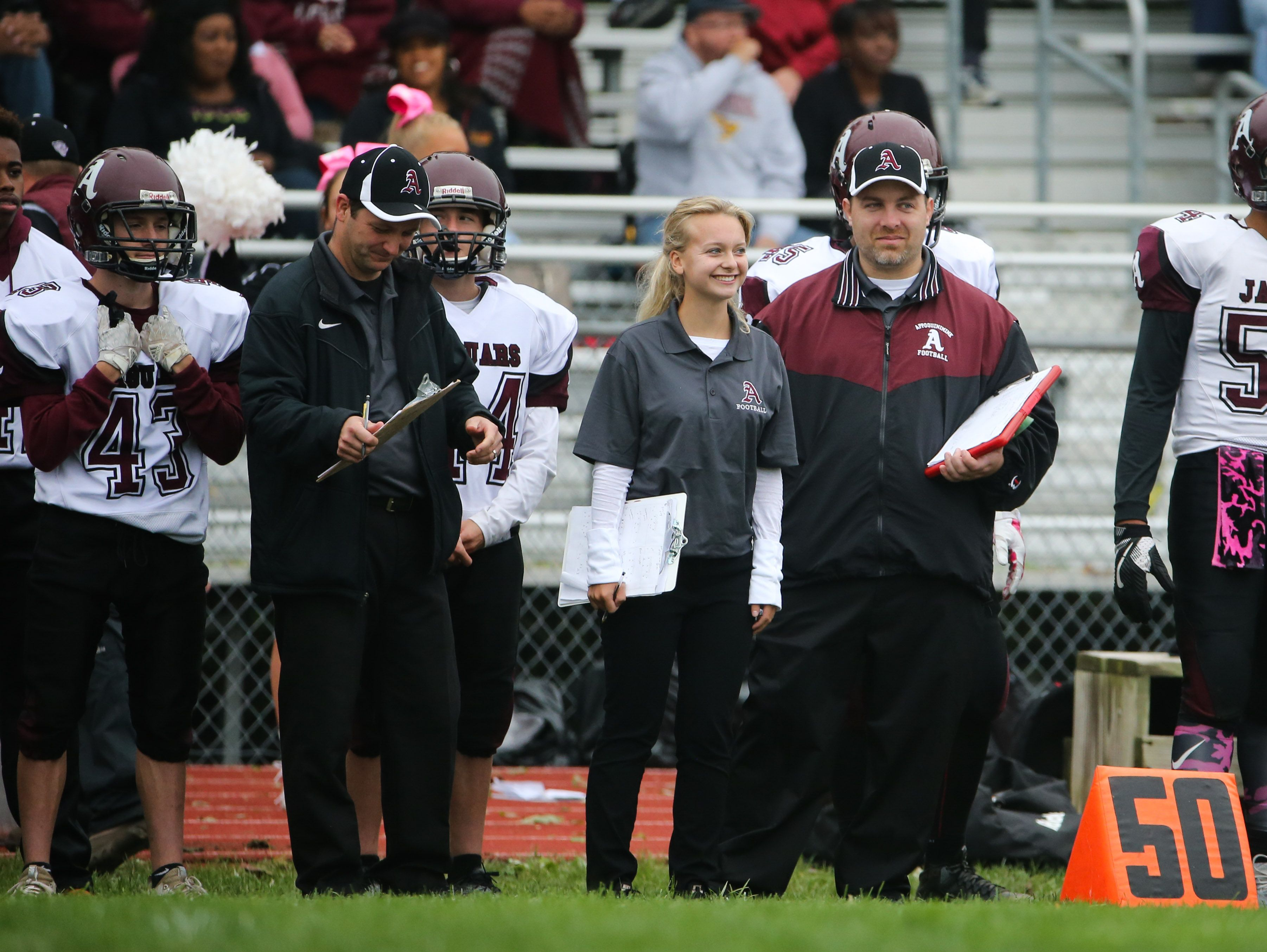 Appoquinimink student associate coach Julia Catalano works on the sideline during the Jaguars' game against Concord last month.