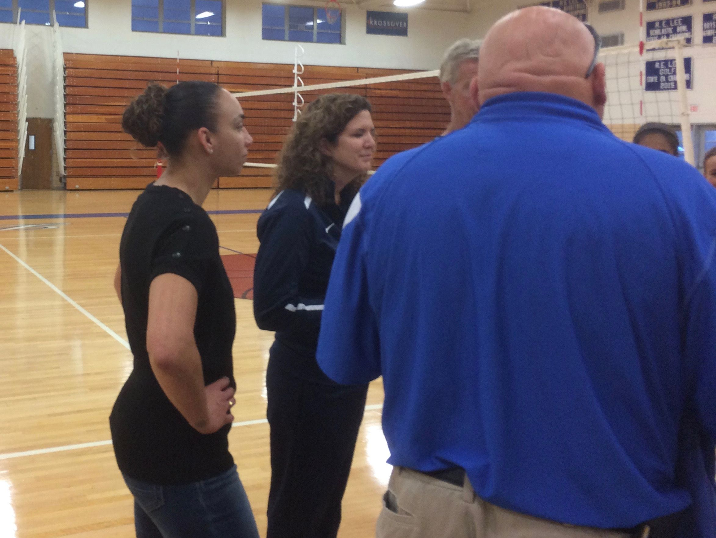 Lee High assistant coach Whitney Vaughn, left, was part of the last Lee team to win a volleyball state championship.