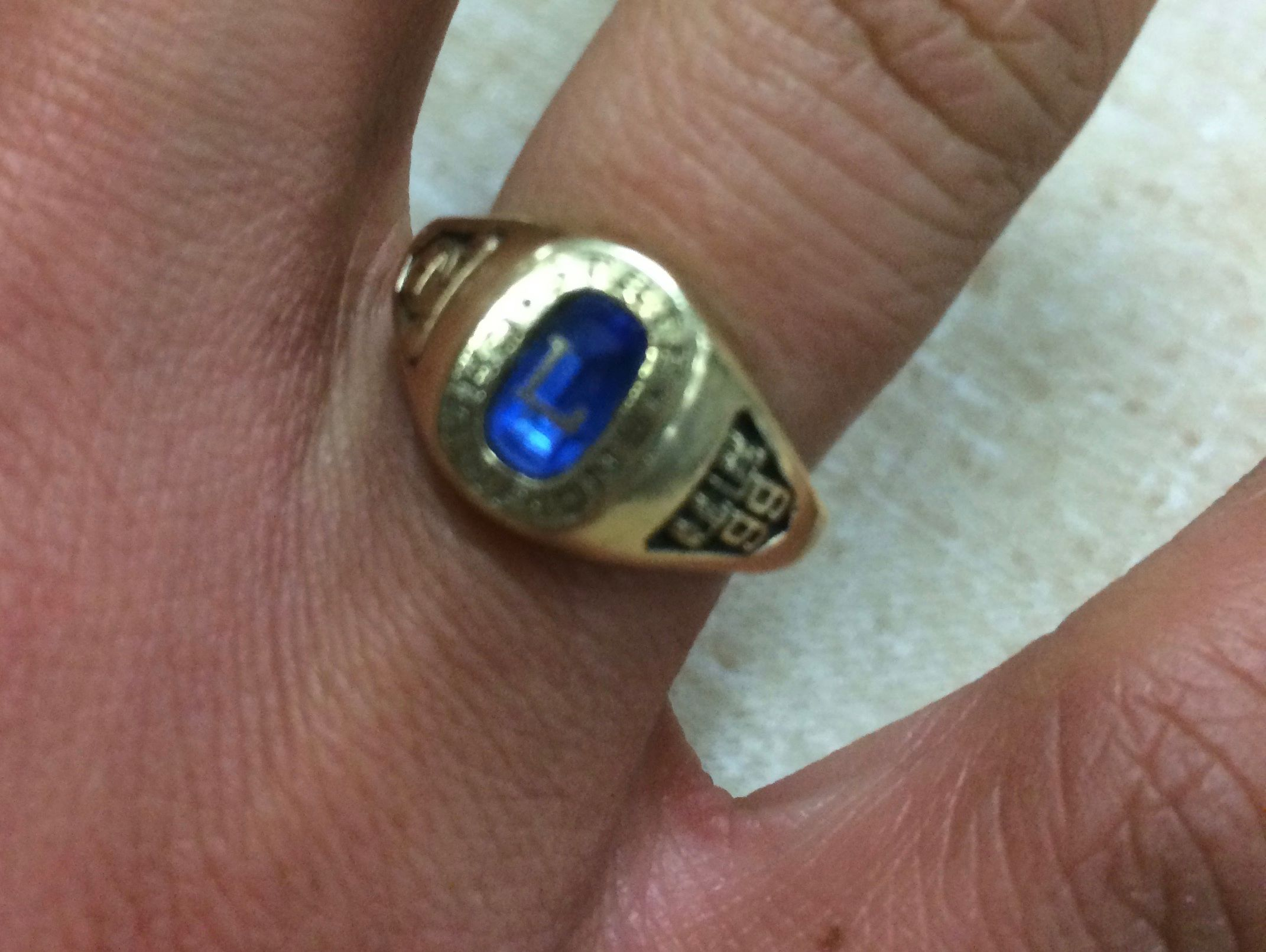 Lee High assistant volleyball coach Whitney Vaughn uses her 1999 state championship ring to motivate the current Lee players as they push for a state title.