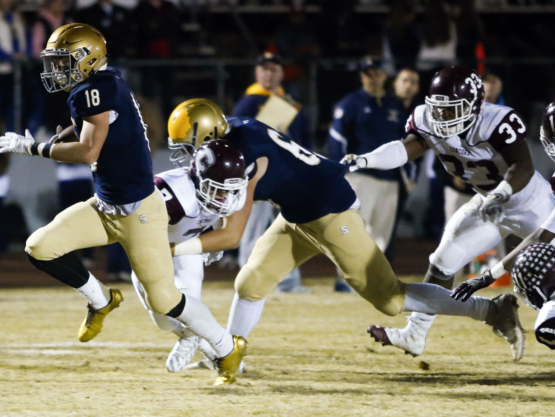 Salesianum's Nick Merlino gets into the Concord secondary before scoring on a run in the second quarter of a DIAA state tournament opening round game at Baynard Stadium Friday.