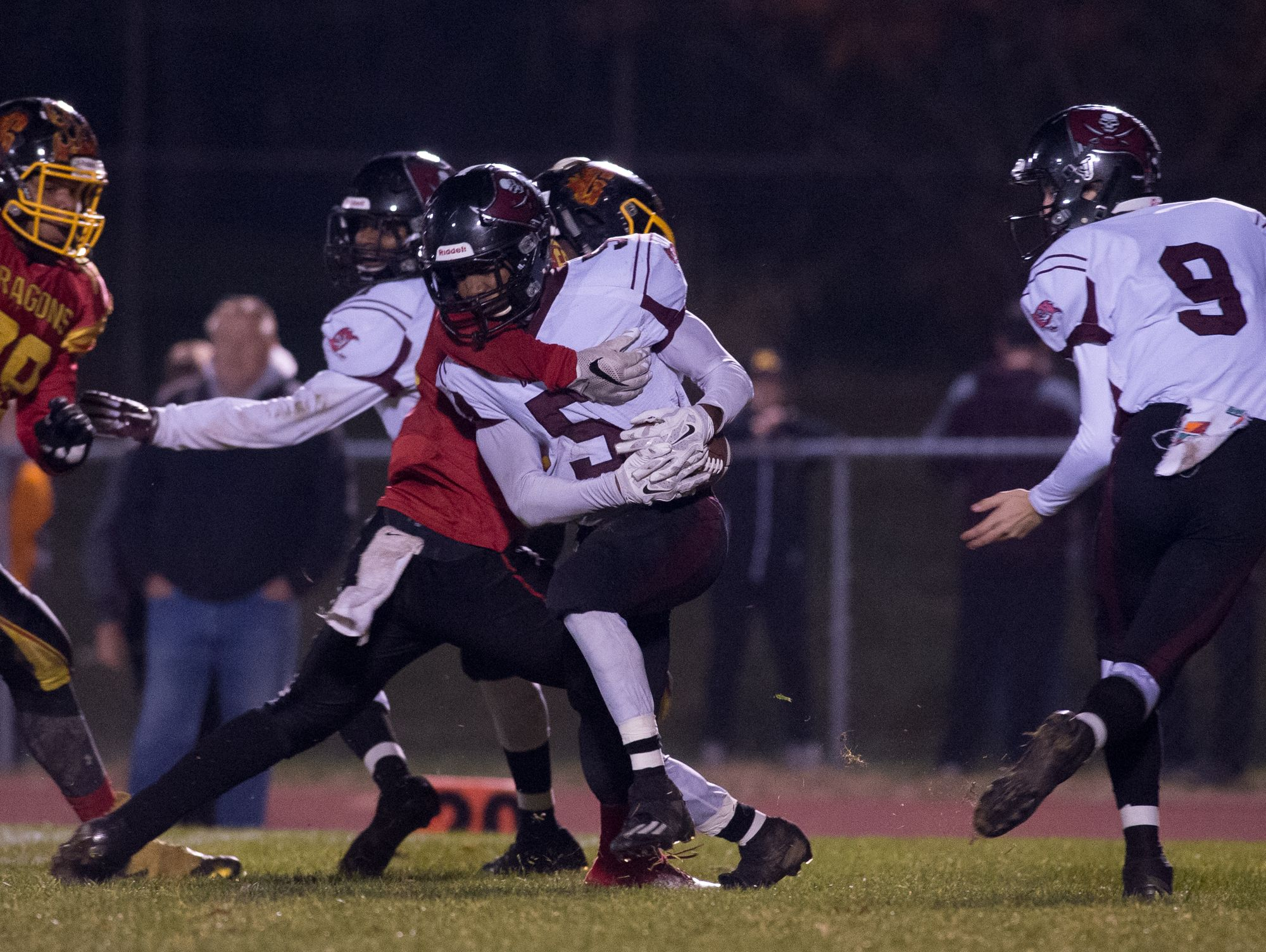 Caravel's Josiah Larkins (5) is quickly tackled by Glasgow's Tyrique Woodland (15) during the second quarter in the opening round of the DIAA Division II playoffs at Glasgow High School.