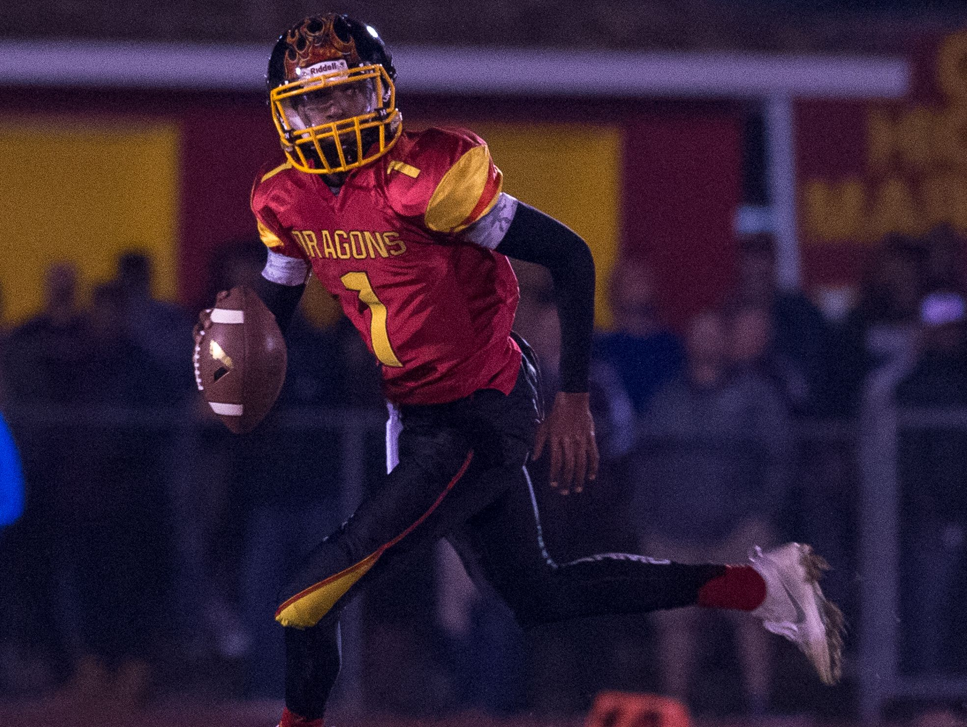 Glasgow's quarterback Isaiah Wilson (1) rolls out looking for a pass during the second quarter against Caravel in the first quarter against Glasgow in the opening round of the DIAA Division II playoffs at Glasgow High School.