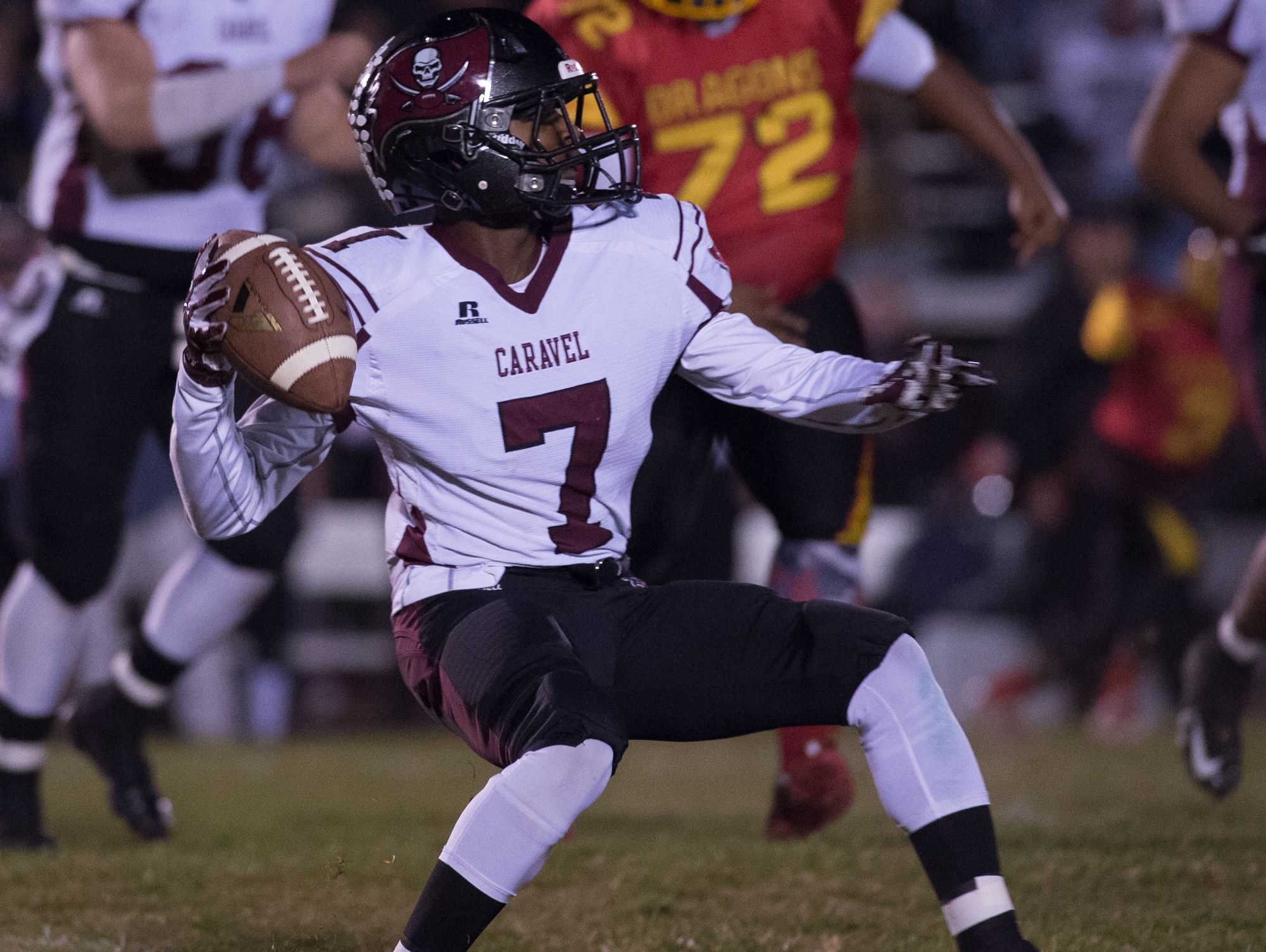 Caravel's Mandela Montgomery (7) throws a pass down the field in the first quarter against Glasgow in the opening round of the DIAA Division II playoffs at Glasgow High School.