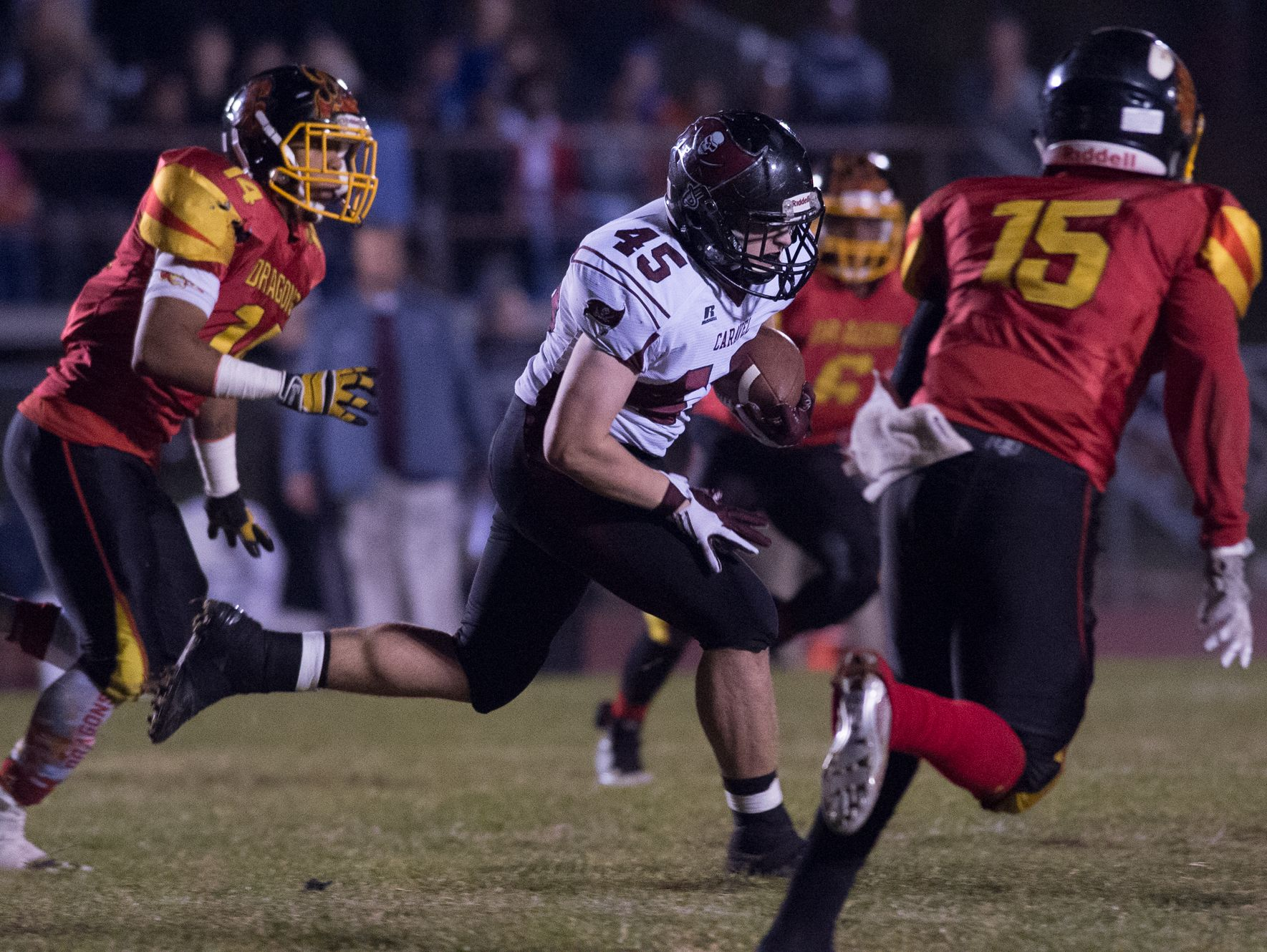 Caravel's Jacob Laznik (45) runs the ball through Glasgow's defense in the opening round of the DIAA Division II playoffs at Glasgow High School.