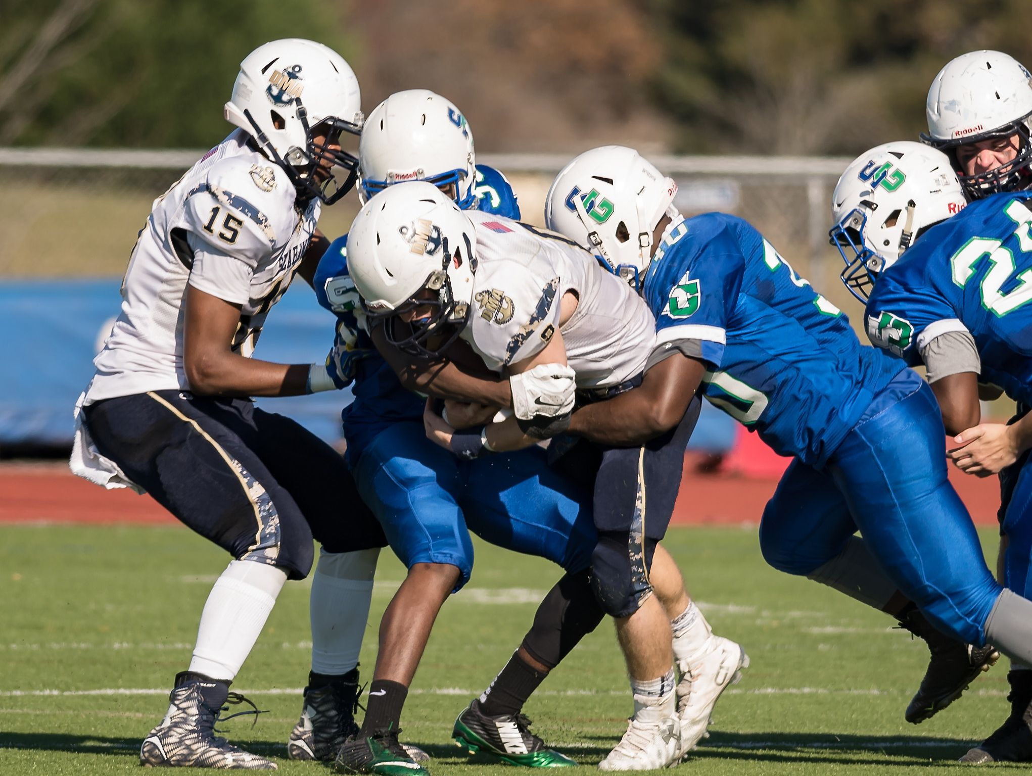 Jacob Hudson, QB for DMA, is brought down by a wall of St. Geroges defenders as DMA plays at St. Georges in the opening round of DIAA Division II playoffs.