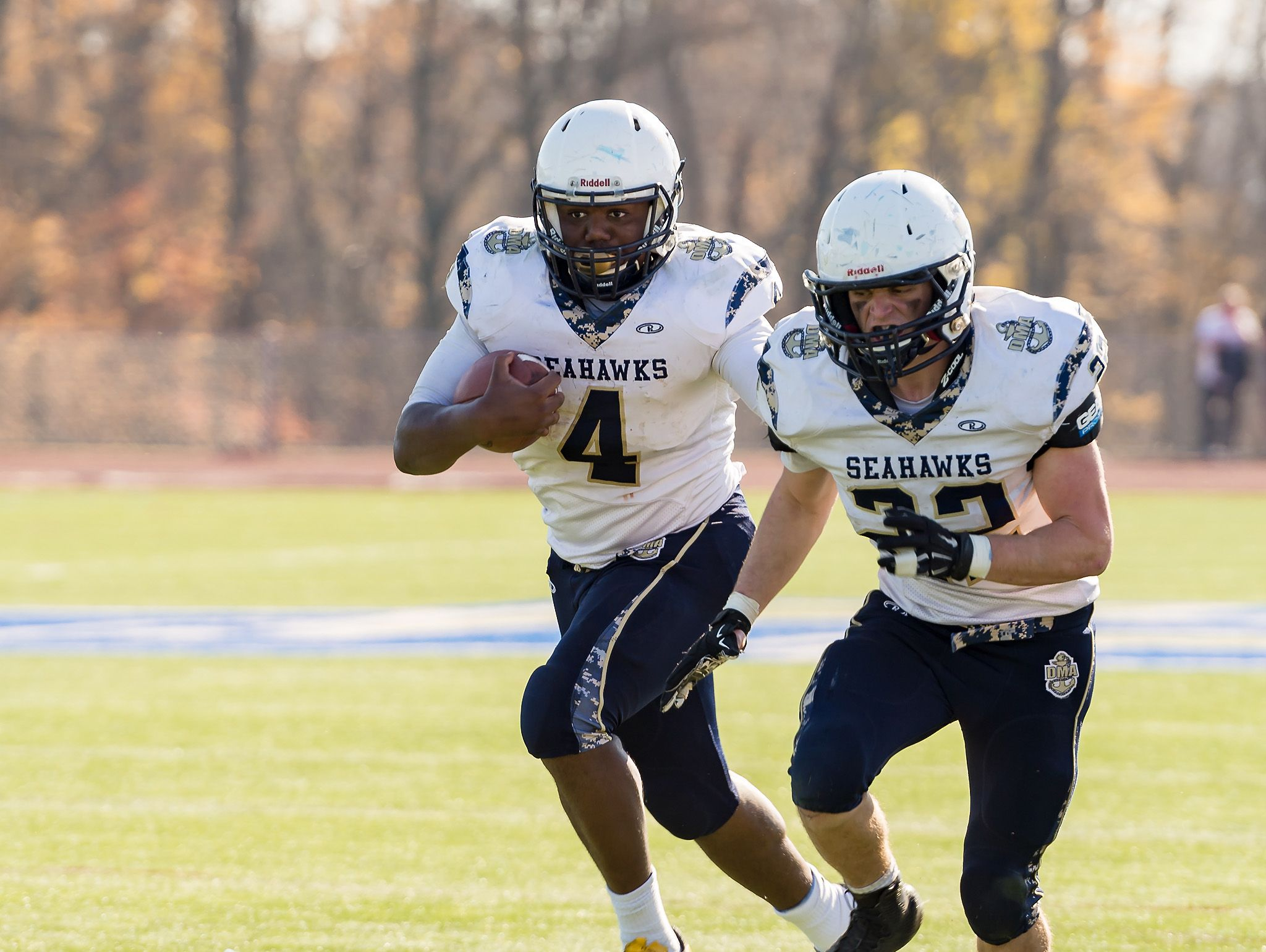 Todd Turner of DMA carries the ball for a touchdown with some blocking help from Brennan Hazewski as DMA plays at St. Georges in the opening round of DIAA Division II playoffs.