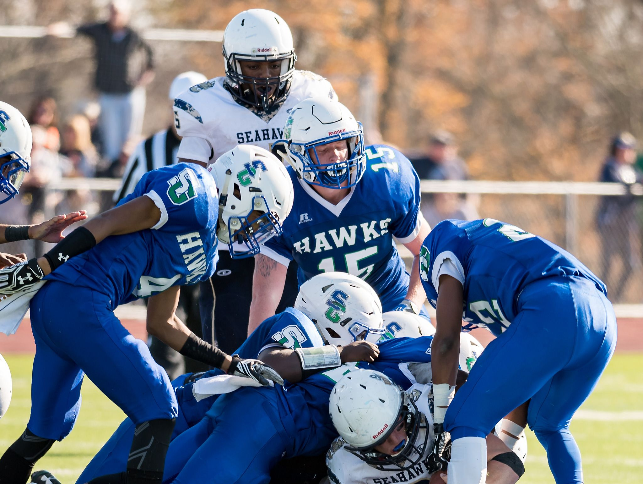 Jacob Hudson of DMA is tackled by a wall of St. Geroges defenders as DMA plays at St. Georges in the opening round of DIAA Division II playoffs.
