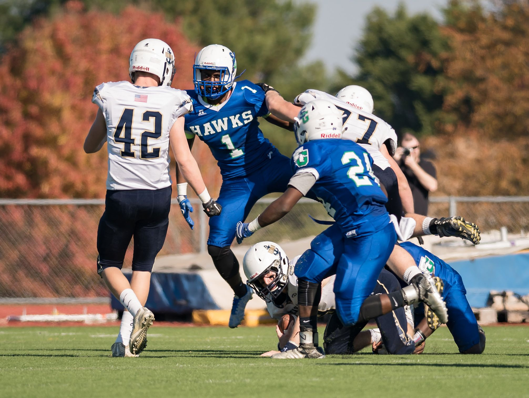 Craig Congo of St. Geroges leaps over Jacob Hudson of DMA as he is sacked as DMA plays at St. Georges in the opening round of DIAA Division II playoffs.