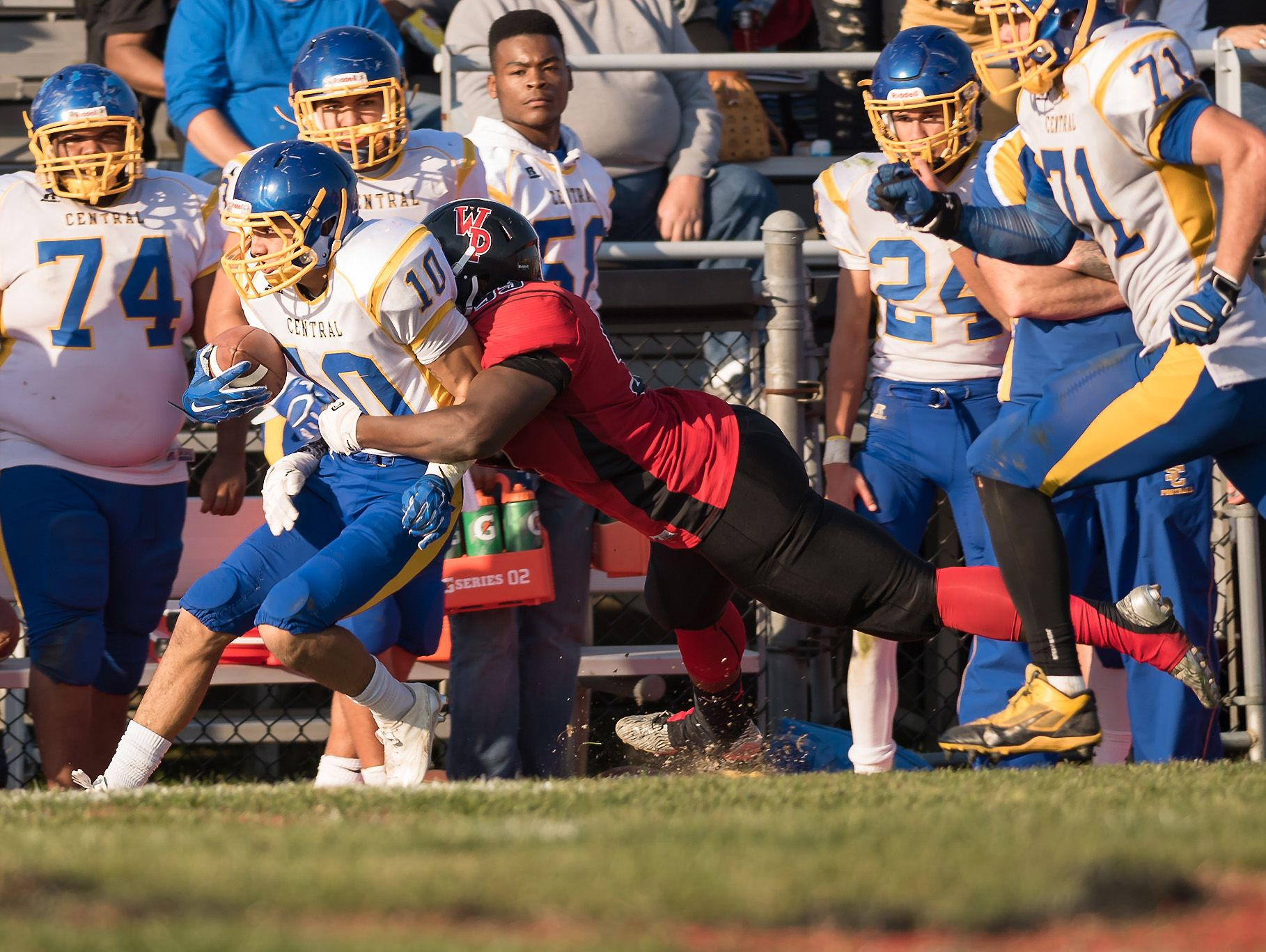 Drew Morris of Sussex Central is tackled by William Penn as Sussex Central plays at William Penn in the opening round of DIAA Division II playoffs.
