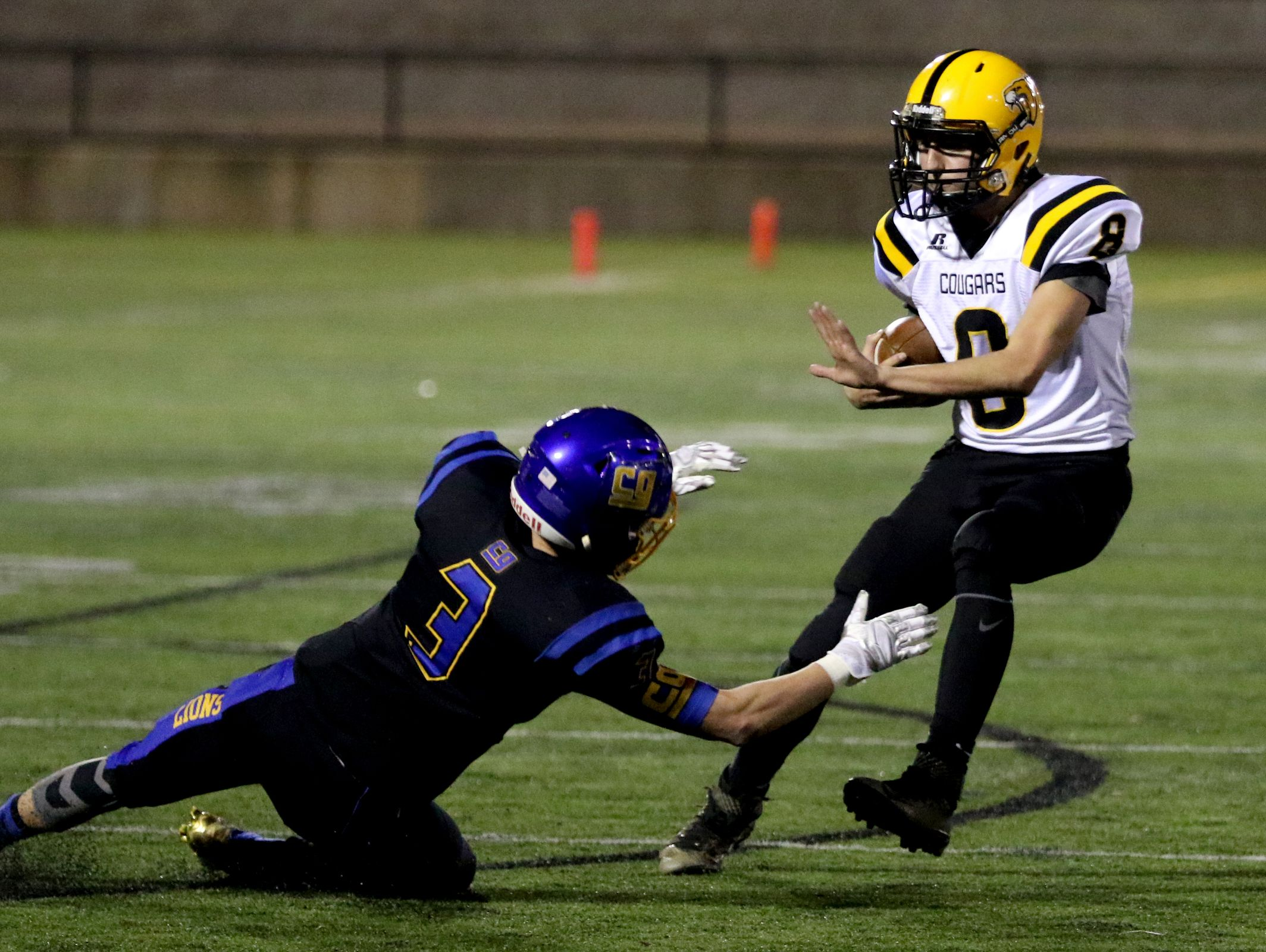 Cascade's Quinn Legner (8) moves past Cottage Grove's Kory Parent (3) in the first half of the Cascade vs. Cottage Grove OSAA Class 4A semifinal football game at Hillsboro Stadium on Saturday, Nov. 19, 2016.