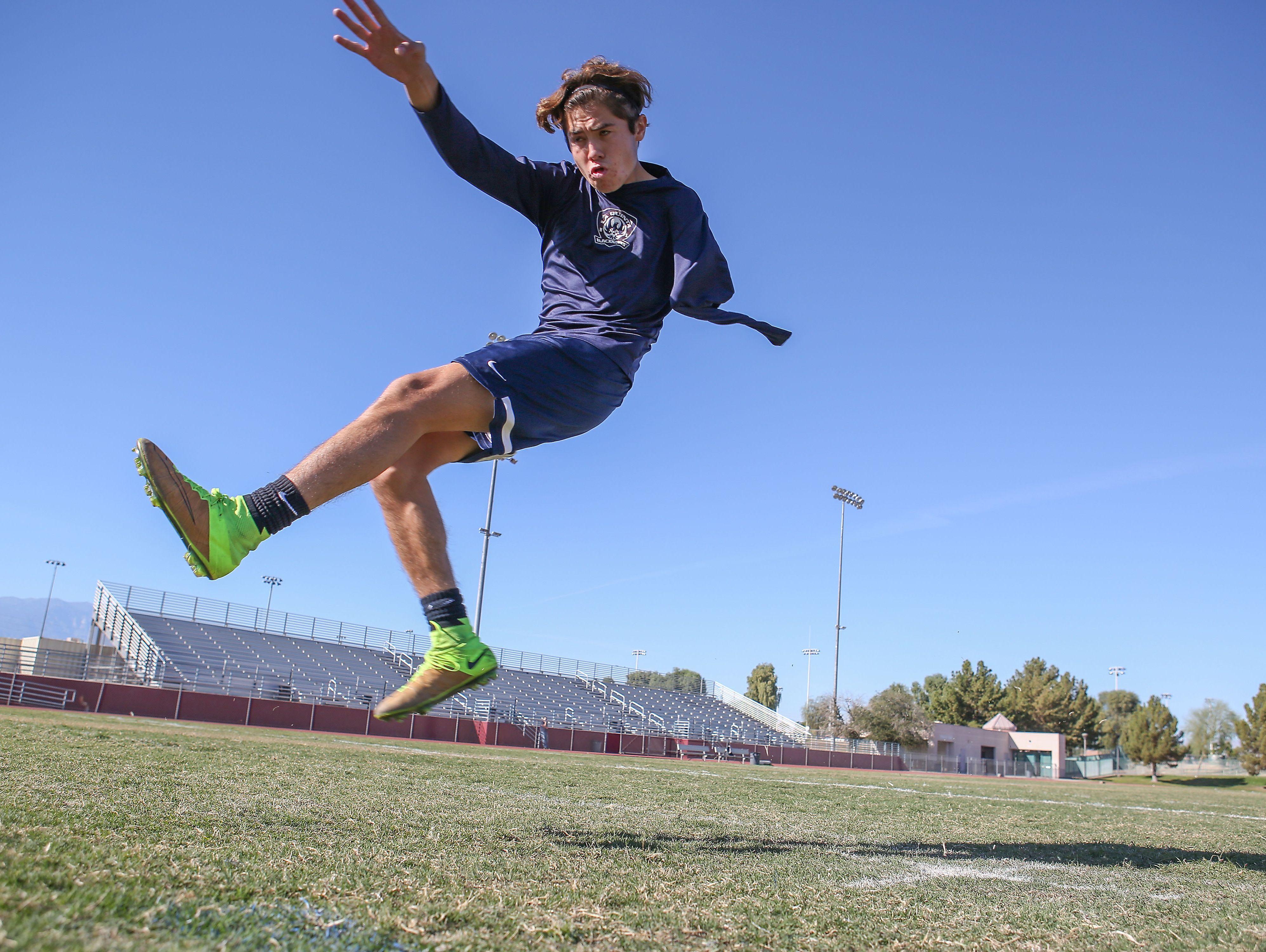 Lucas Rosales, a senior soccer player at La Quinta High School, follows through on a shot while practicing, November 22, 2016.