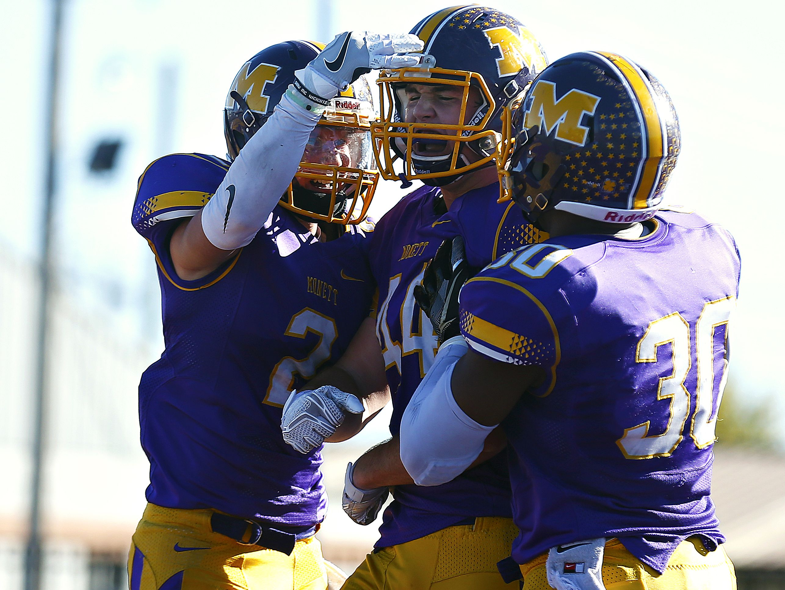 Monett High School tight end Alex Turner (44) celebrates with his teammates after scoring a touchdown during the second quarter of the Class 3 quarterfinal playoff game against Owensville High School at Burl Fowler Stadium in Monett.